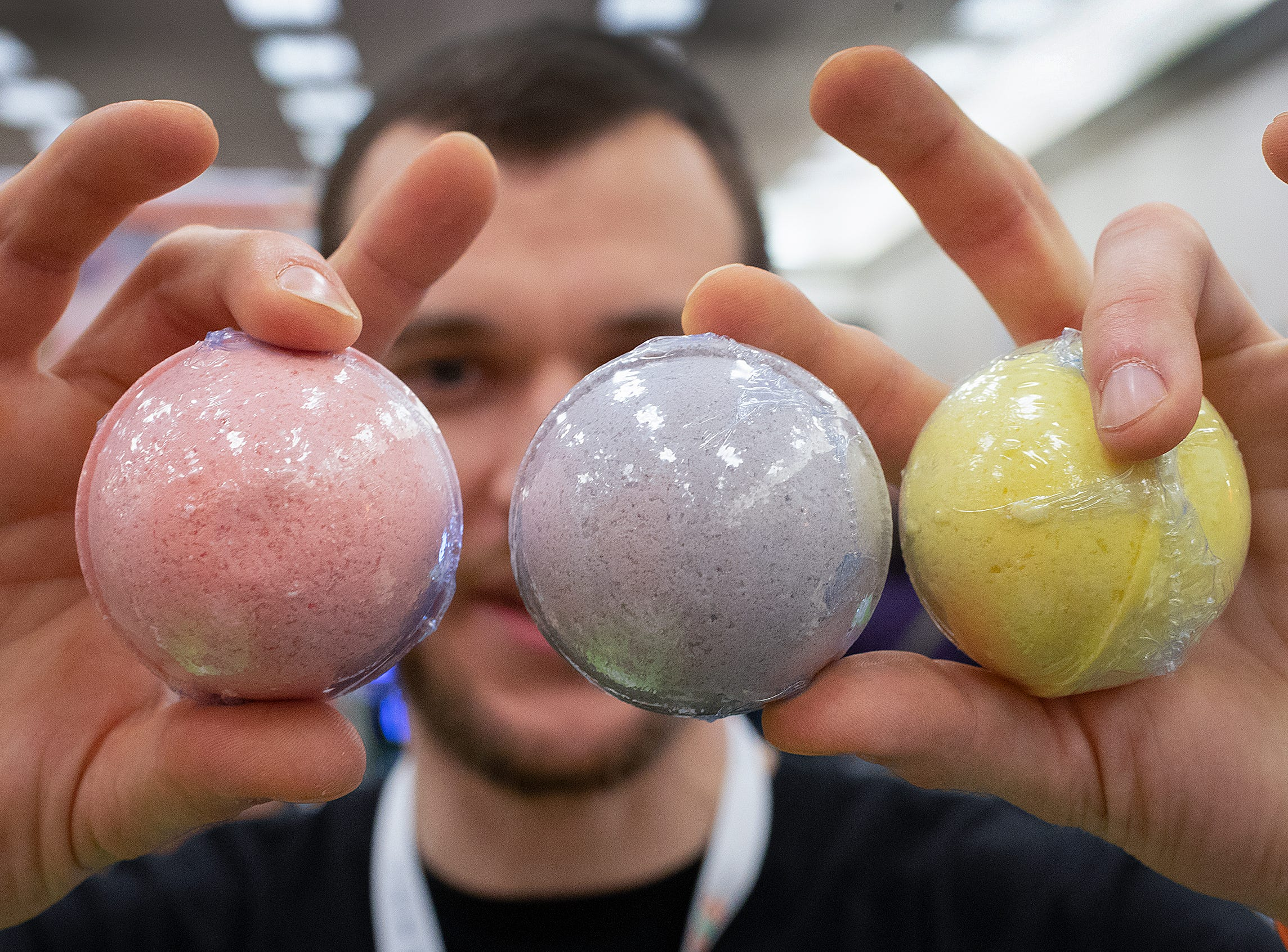 Michael Walker from Ultra CBD hold his company's bathbombs that come in three scents vanilla lavender, lemon grapefruit and pepperming menthol at the CBD Expo at the Marriott East in Indianapolis on Friday, Mar. 15, 2019.
