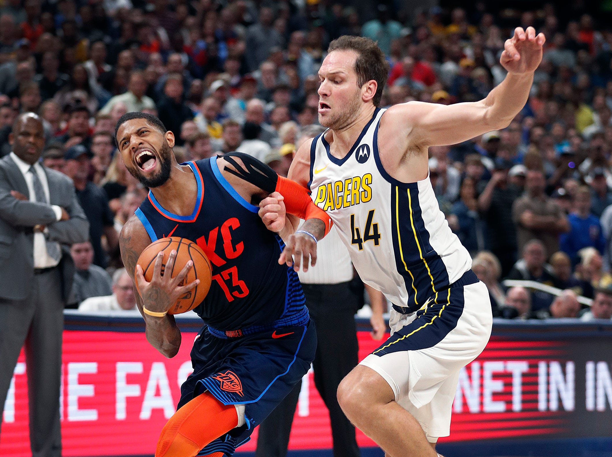 Oklahoma City Thunder forward Paul George (13) attempts to drive around Indiana Pacers forward Bojan Bogdanovic (44) in the second half of their game at Bankers Life Fieldhouse on Thursday, Mar. 14, 2019. The Pacers defeated the Thunder 108-106.