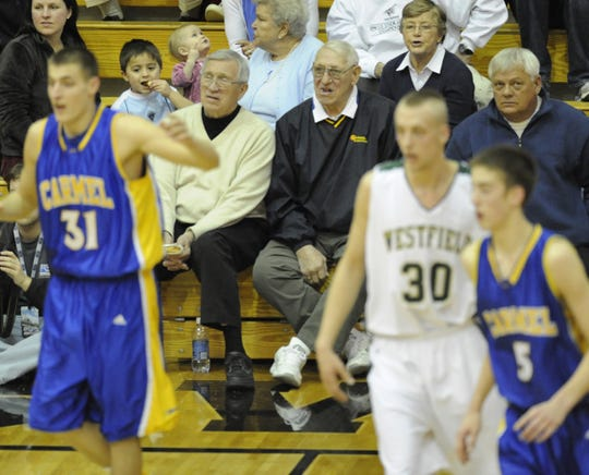 FILE - Former Carmel basketball coaches Bill Shepherd Sr. (left, white sweater) and Eric Clark, watch game action.