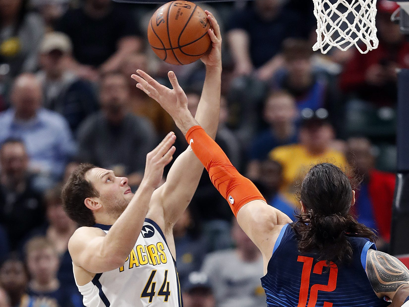 Indiana Pacers forward Bojan Bogdanovic (44) pulls in a rebound away from Oklahoma City Thunder center Steven Adams (12) in the first half of their game at Bankers Life Fieldhouse on Thursday, Mar. 14, 2019.