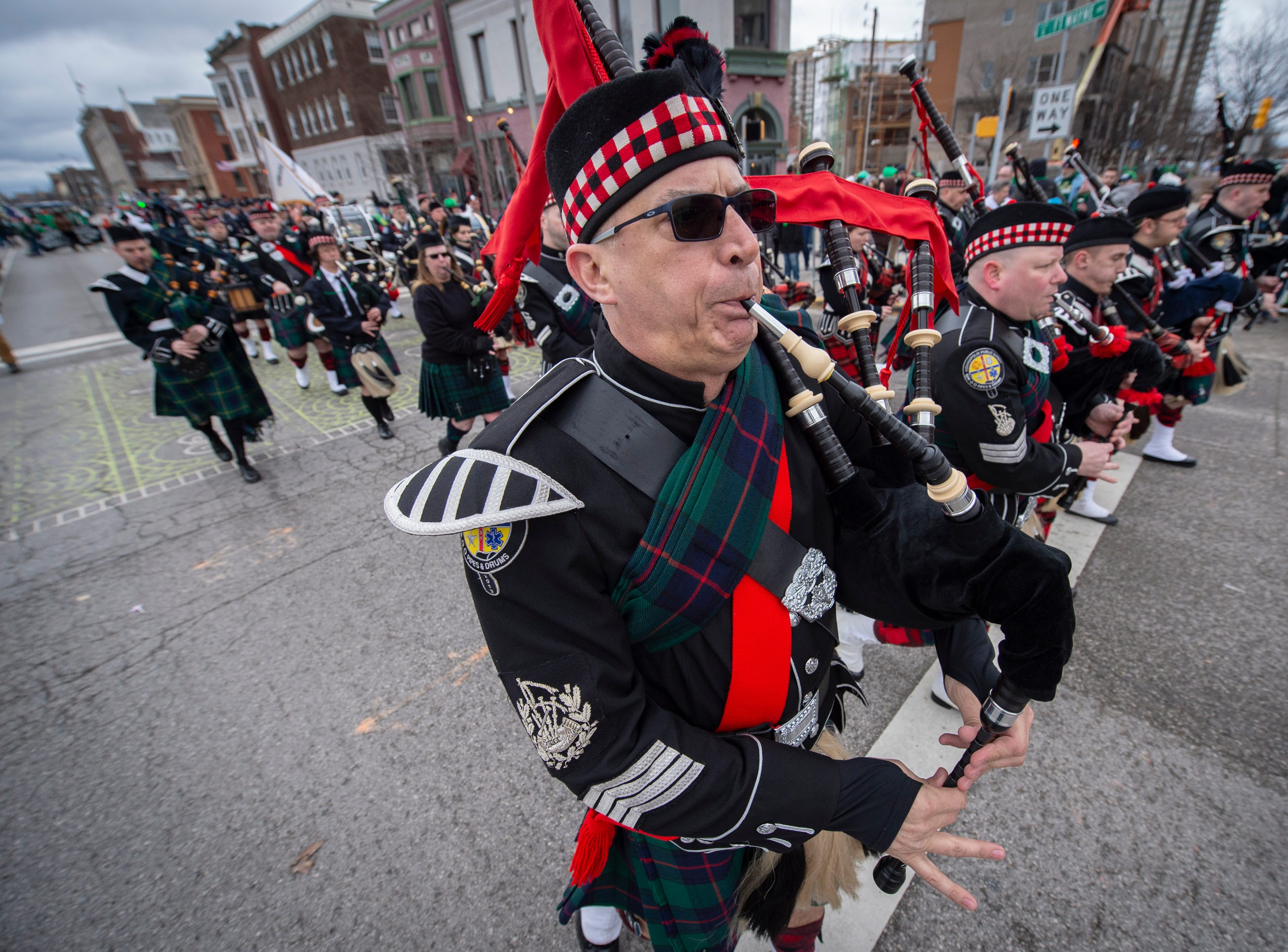 The Indianapolis Public Safety Pipes and Drums unit perform along the parade route. The 39th annual St. Patrick's Day Parade navigated the streets of Indianapolis, Friday, March 15, 2019.