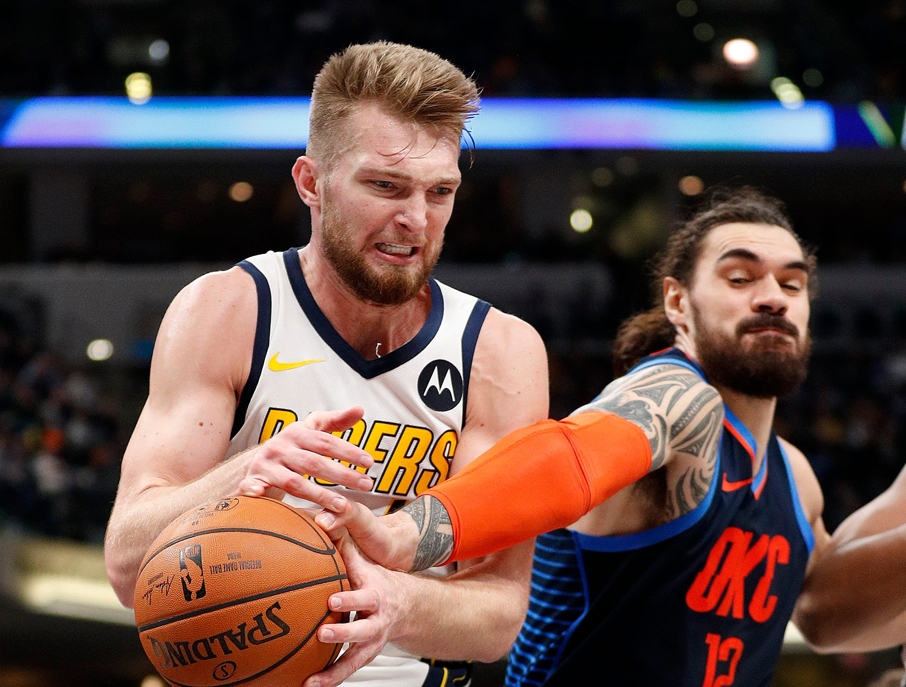 Indiana Pacers forward Domantas Sabonis (11) pulls a rebound away from Oklahoma City Thunder center Steven Adams (12) in the second half of their game at Bankers Life Fieldhouse on Thursday, Mar. 14, 2019. The Pacers defeated the Thunder 108-106.