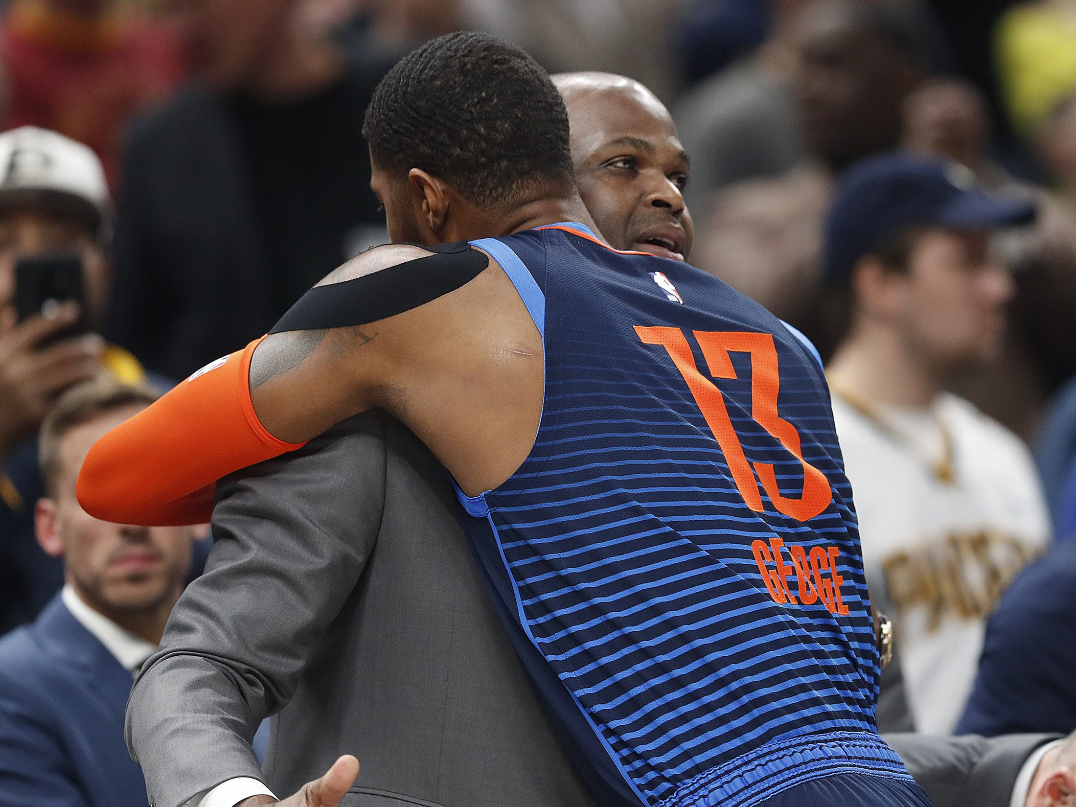 Indiana Pacers head coach Nate McMillan gets a hug from his former player Oklahoma City Thunder forward Paul George (13) in the first half of their game at Bankers Life Fieldhouse on Thursday, Mar. 14, 2019.