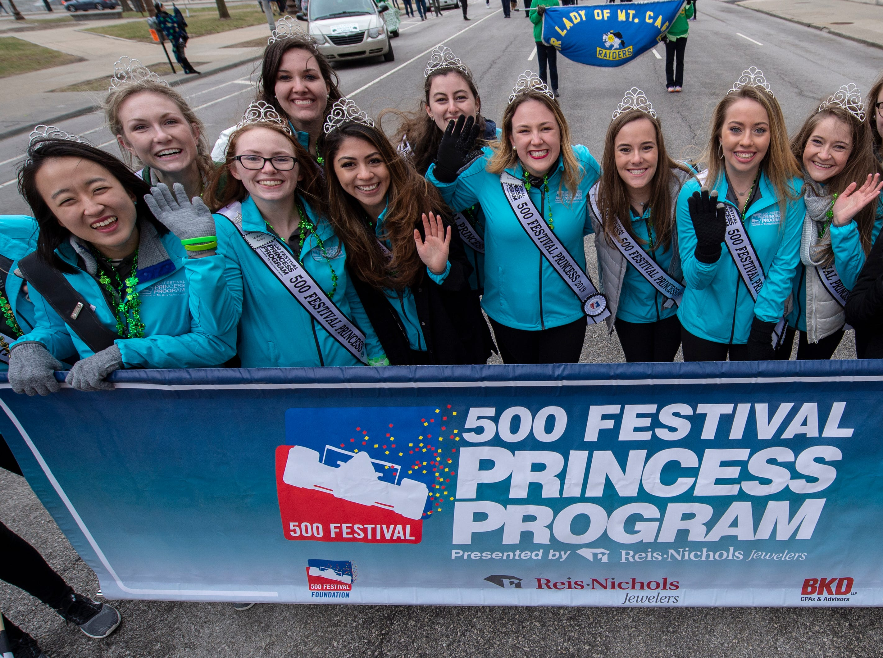500 Festival Princesses pose for a photo before making their way along the parade route. The 39th annual St. Patrick's Day Parade navigated the streets of Indianapolis, Friday, March 15, 2019.