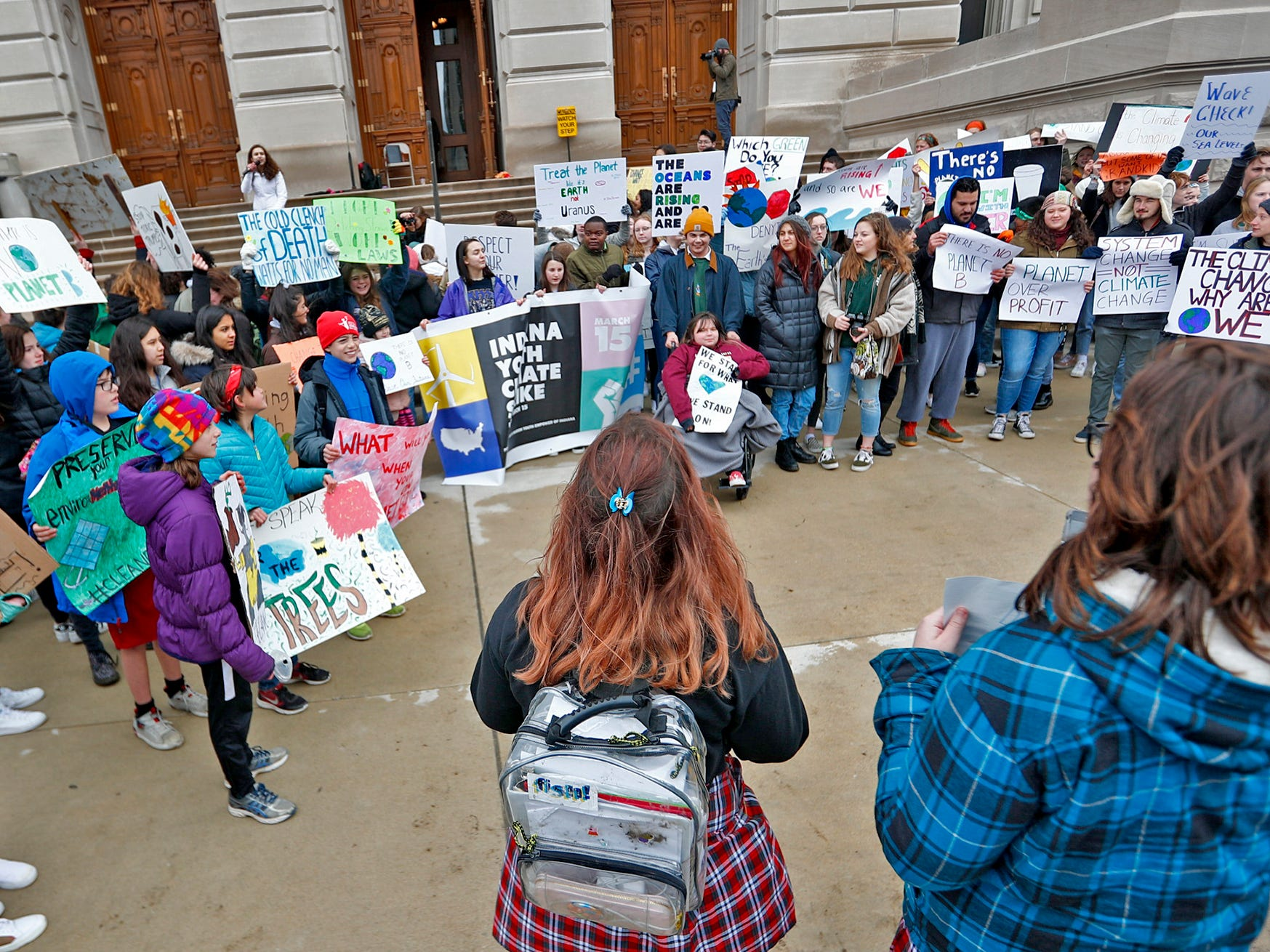 Students come together during the Indiana part of the international Climate Strike, Friday, March 15, 2019, held outside the Indiana Statehouse.  Following in the footsteps of 16-year-old Swedish trailblazer, Greta Thunberg, students around the world are skipping school to protest government inaction on climate change.  The Indiana protest brought over 250 participants.