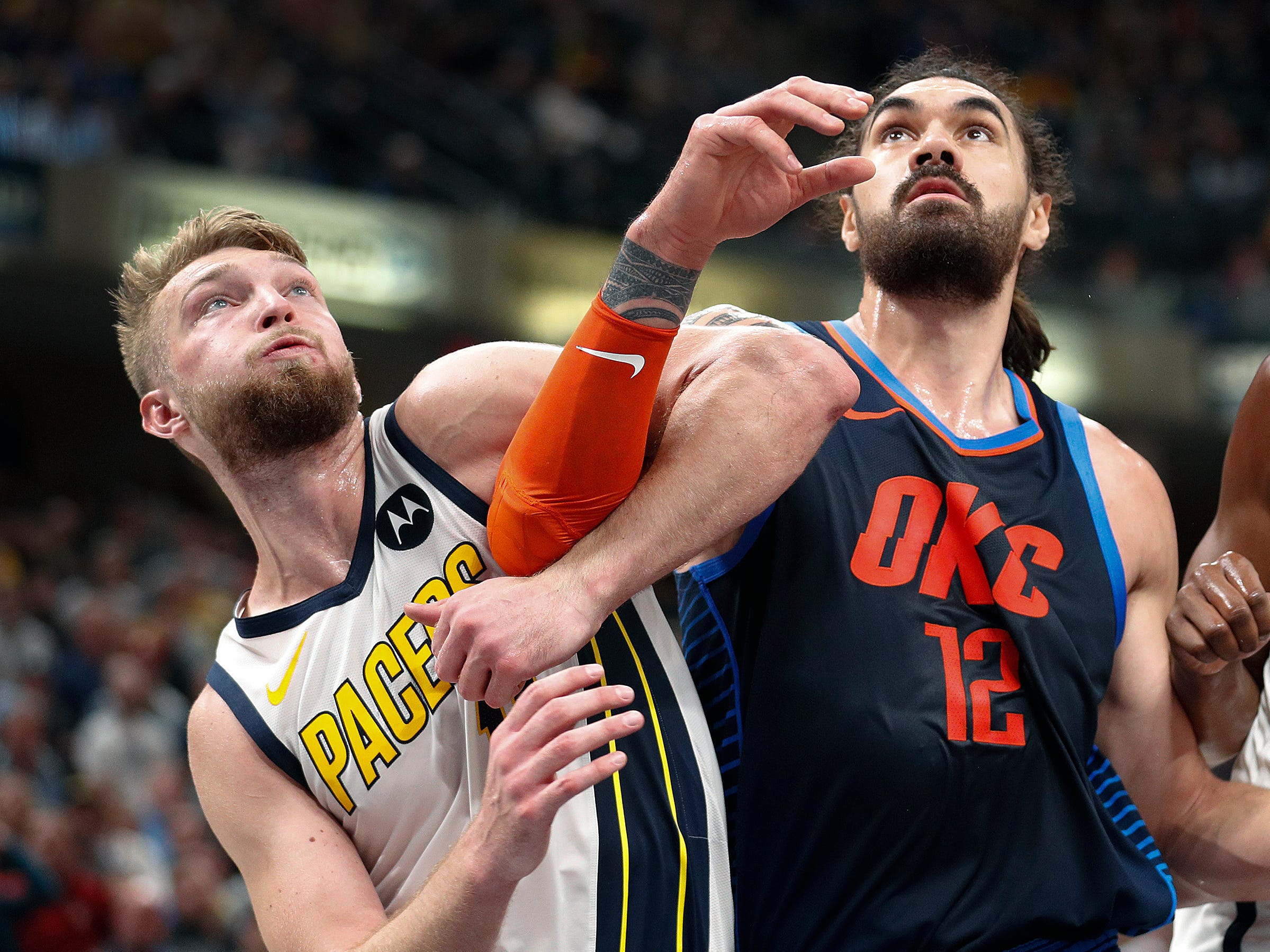 Indiana Pacers forward Domantas Sabonis (11) and Oklahoma City Thunder center Steven Adams (12) lock arms fighting for position in the second half of their game at Bankers Life Fieldhouse on Thursday, Mar. 14, 2019. The Pacers defeated the Thunder 108-106.