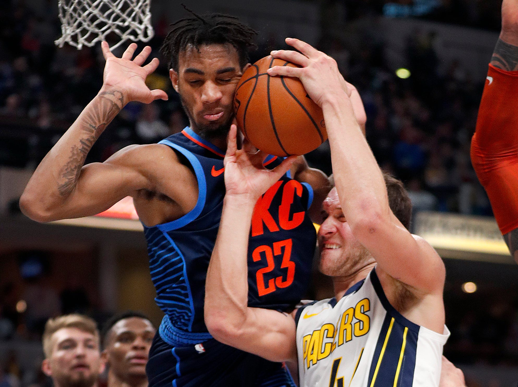 Indiana Pacers forward Bojan Bogdanovic (44) is fouled by Oklahoma City Thunder guard Terrance Ferguson (23) in the second half of their game at Bankers Life Fieldhouse on Thursday, Mar. 14, 2019. The Pacers defeated the Thunder 108-106.