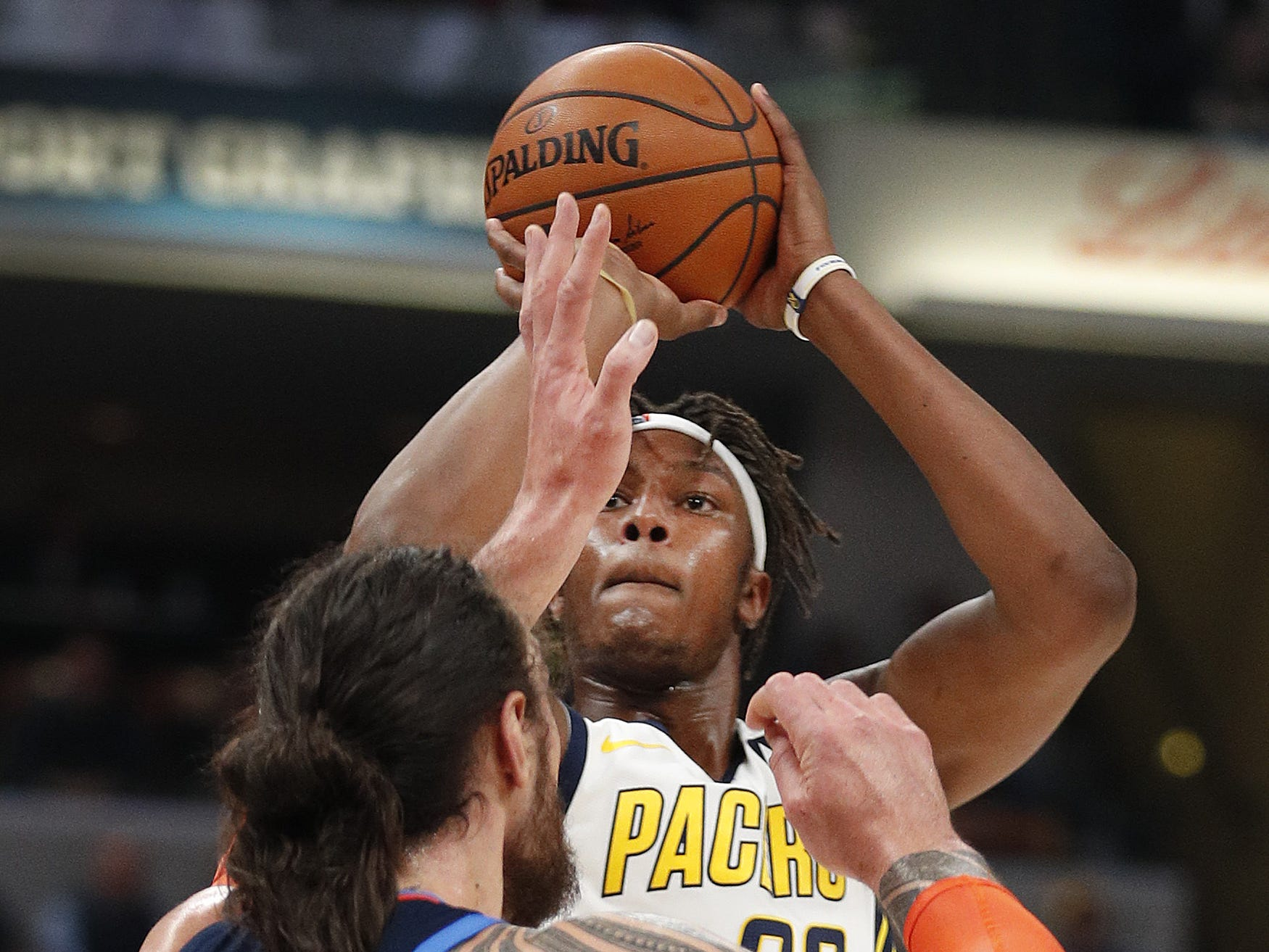 Indiana Pacers center Myles Turner (33) shoots over Oklahoma City Thunder center Steven Adams (12) in the first half of their game at Bankers Life Fieldhouse on Thursday, Mar. 14, 2019.