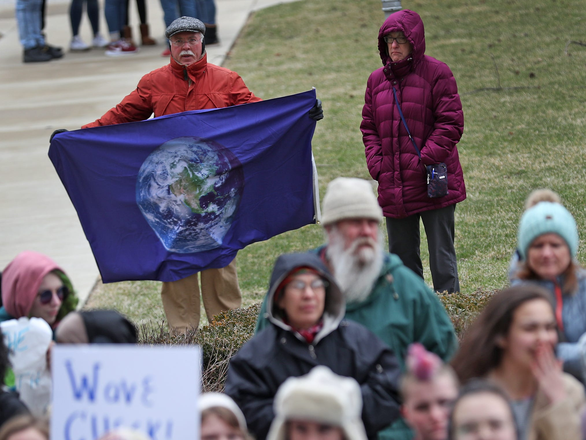 Students and supporters come together during the Indiana part of the international Climate Strike, Friday, March 15, 2019, held outside the Indiana Statehouse.  Following in the footsteps of 16-year-old Swedish trailblazer, Greta Thunberg, students around the world are skipping school to protest government inaction on climate change.  The Indiana protest brought over 250 participants.