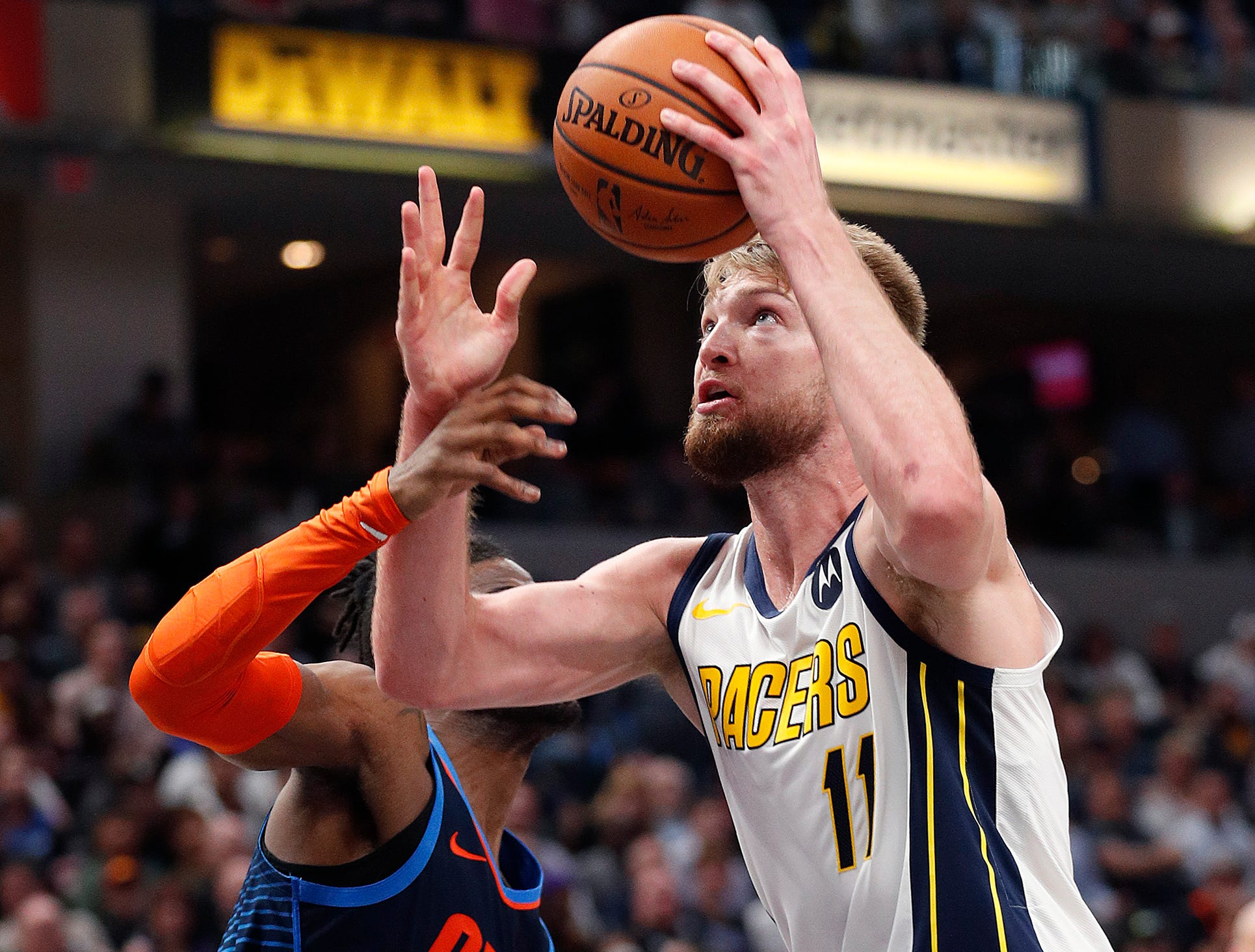 Indiana Pacers forward Domantas Sabonis (11) puts in a basket over Oklahoma City Thunder forward Nerlens Noel (3) in the second half of their game at Bankers Life Fieldhouse on Thursday, Mar. 14, 2019. The Pacers defeated the Thunder 108-106.