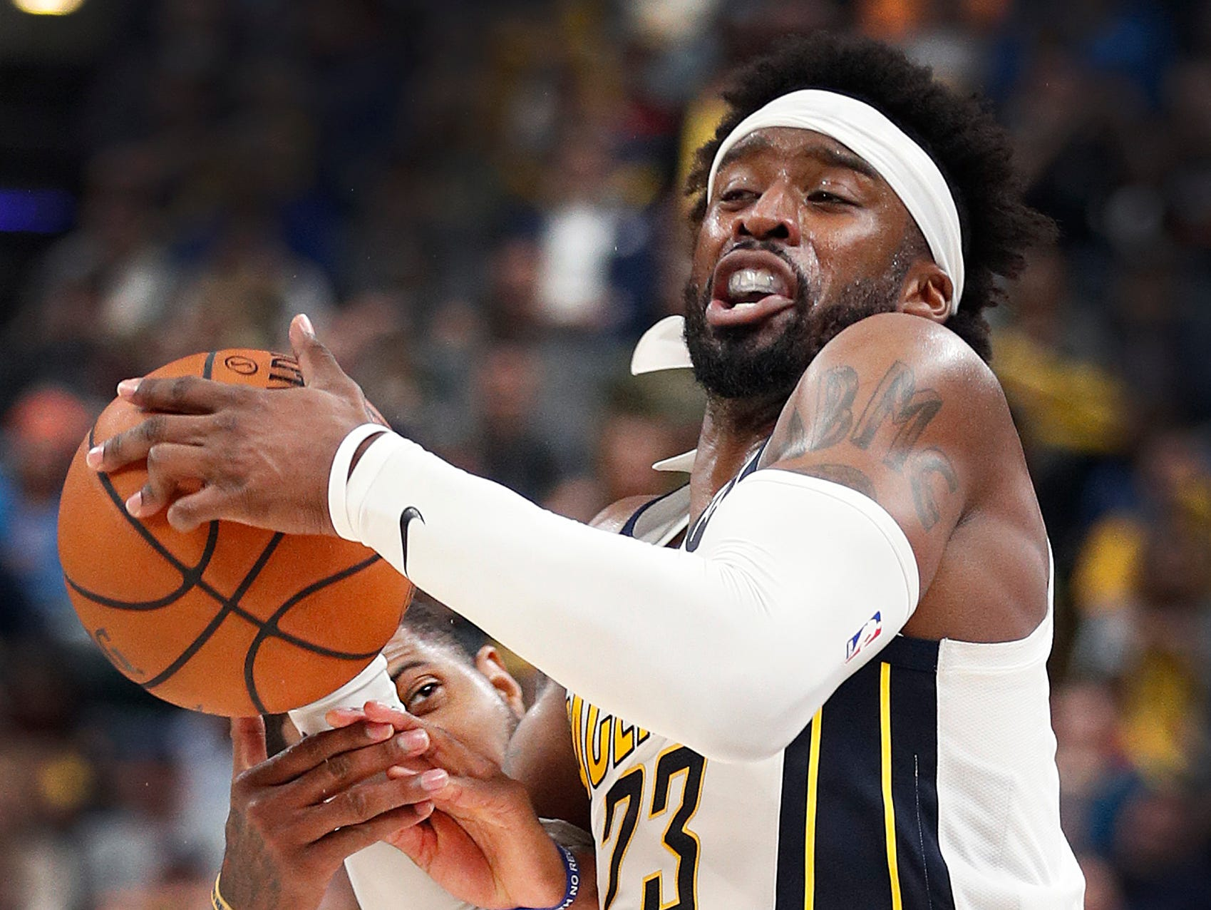 Indiana Pacers guard Wesley Matthews (23) is fouled by Oklahoma City Thunder forward Paul George (13) in the second half of their game at Bankers Life Fieldhouse on Thursday, Mar. 14, 2019. The Pacers defeated the Thunder 108-106.