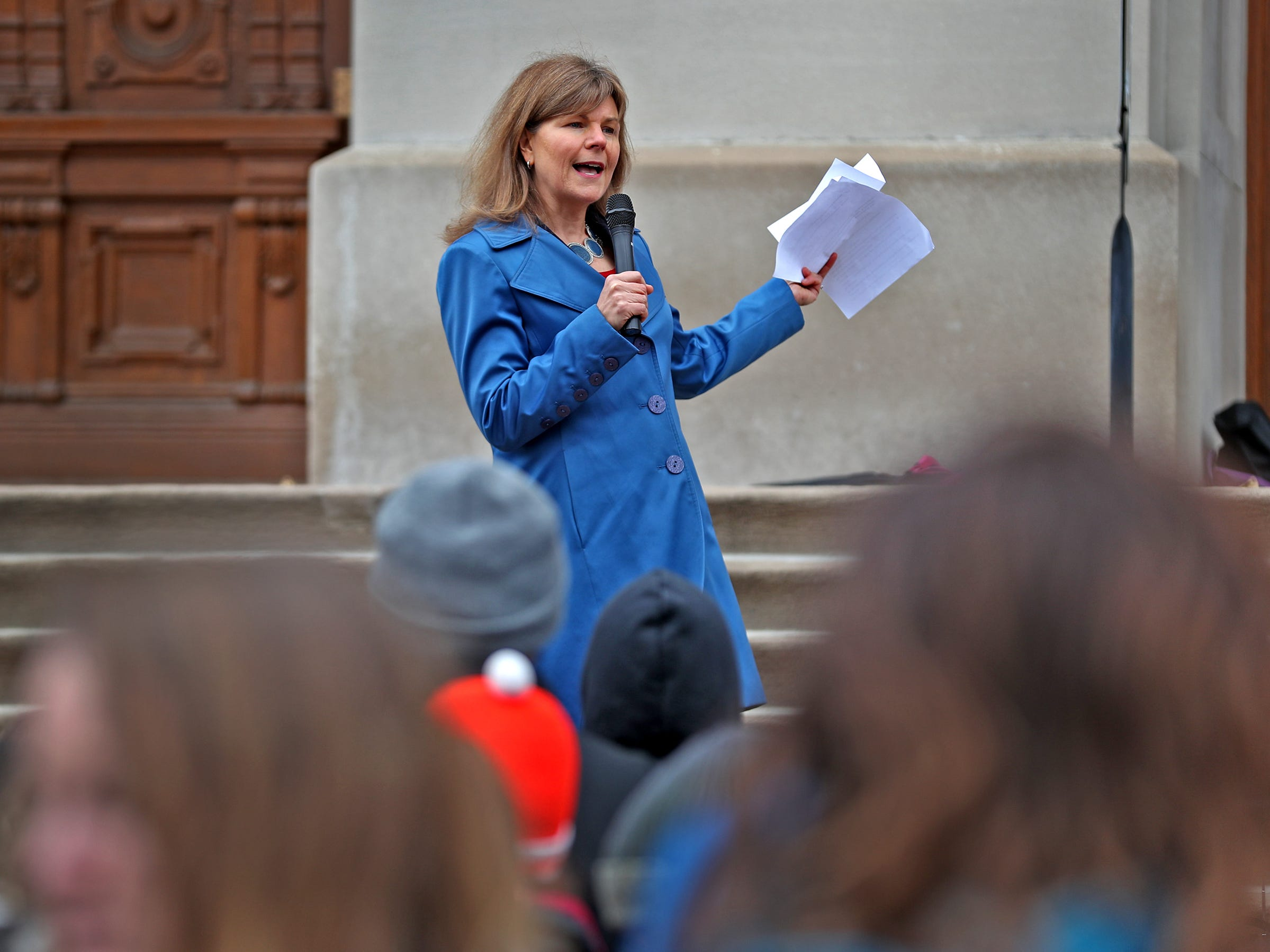 Indiana Representative Carey Hamilton addresses the crowd during the Indiana part of the international Climate Strike, Friday, March 15, 2019, held outside the Indiana Statehouse.  Following in the footsteps of 16-year-old Swedish trailblazer, Greta Thunberg, students around the world are skipping school to protest government inaction on climate change.