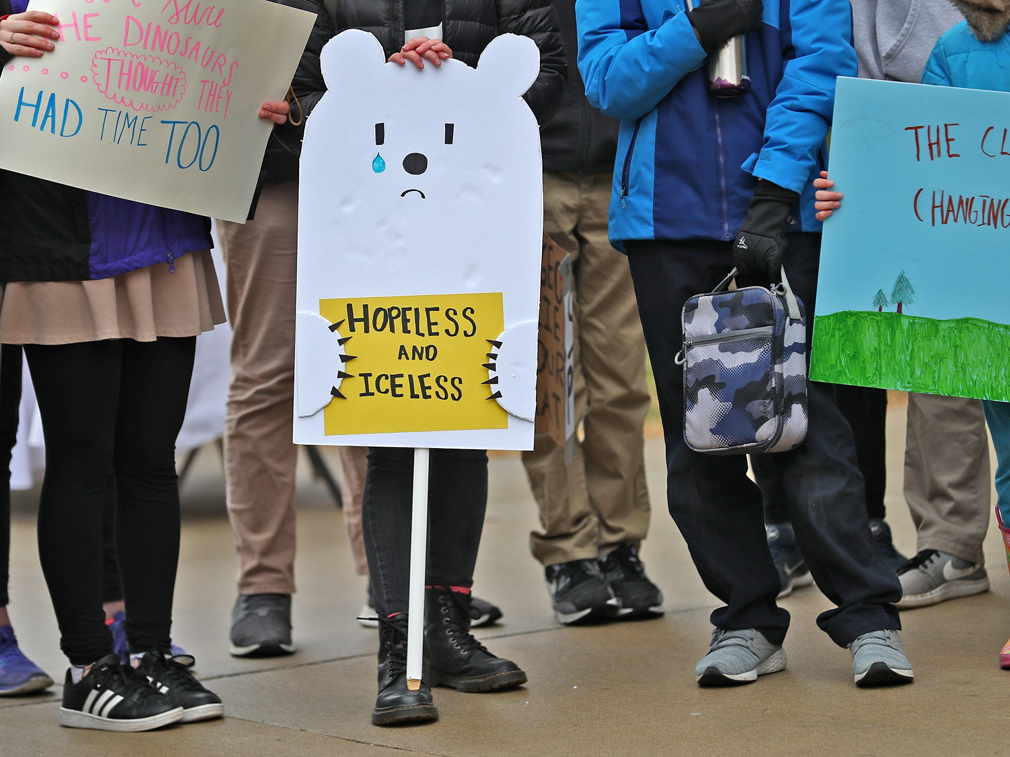 uStudents come together with a variety of signs during the Indiana part of the international Climate Strike, Friday, March 15, 2019, held outside the Indiana Statehouse.  Following in the footsteps of 16-year-old Swedish trailblazer, Greta Thunberg, students around the world are skipping school to protest government inaction on climate change.  The Indiana protest brought over 250 participants.