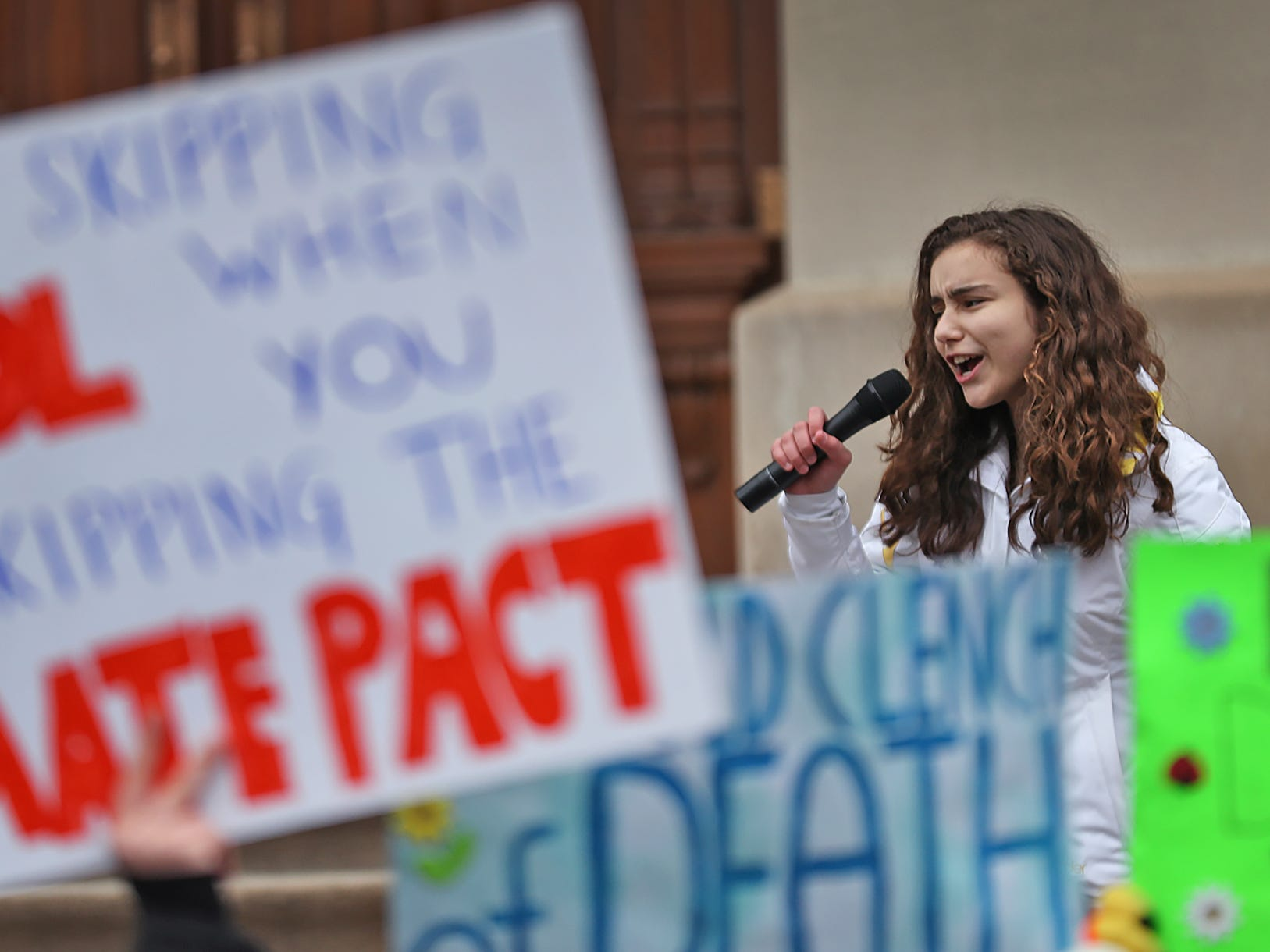 Carmel High School sophomore Isabella Fallahi leads students in chants, as they come together during the Indiana part of the international Climate Strike, Friday, March 15, 2019, held outside the Indiana Statehouse.  Following in the footsteps of 16-year-old Swedish trailblazer, Greta Thunberg, students around the world are skipping school to protest government inaction on climate change.  The Indiana protest brought over 250 participants.