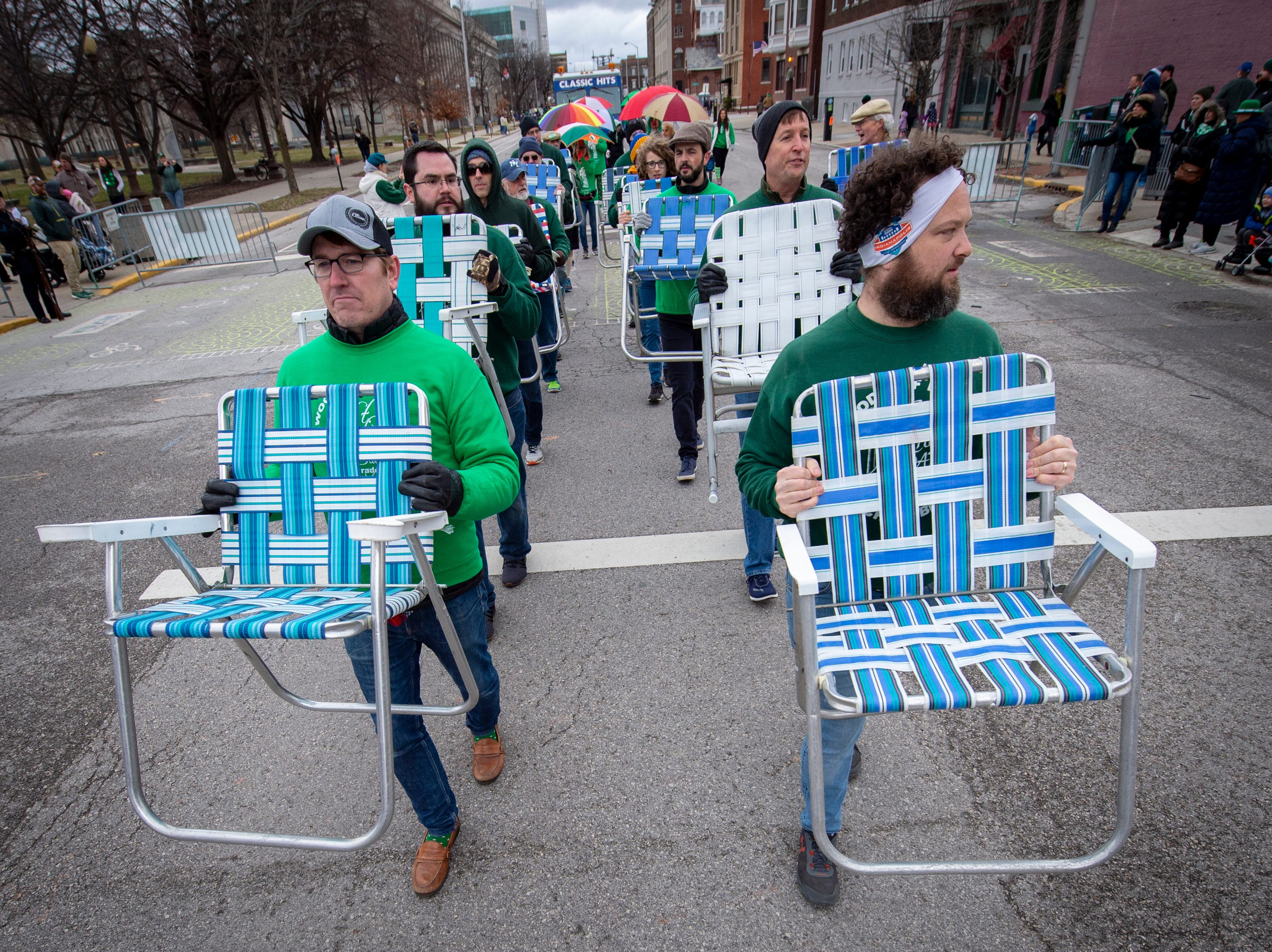 Members of the Woodruff Place Lawn Chair Brigade perform on the parade route. The 39th annual St. Patrick's Day Parade navigated the streets of Indianapolis, Friday, March 15, 2019.