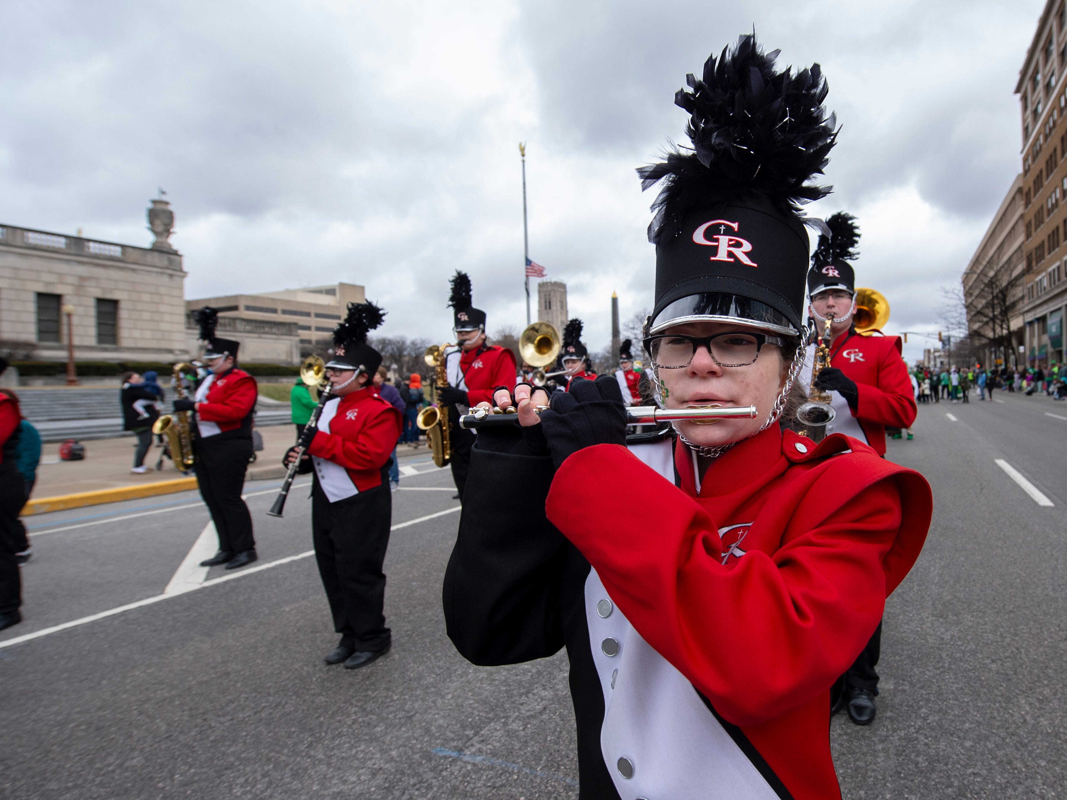 Mariah Martin plays her piccolo with the Cardinal Ritter Marching Band in the parade. The 39th annual St. Patrick's Day Parade navigated the streets of Indianapolis, Friday, March 15, 2019.