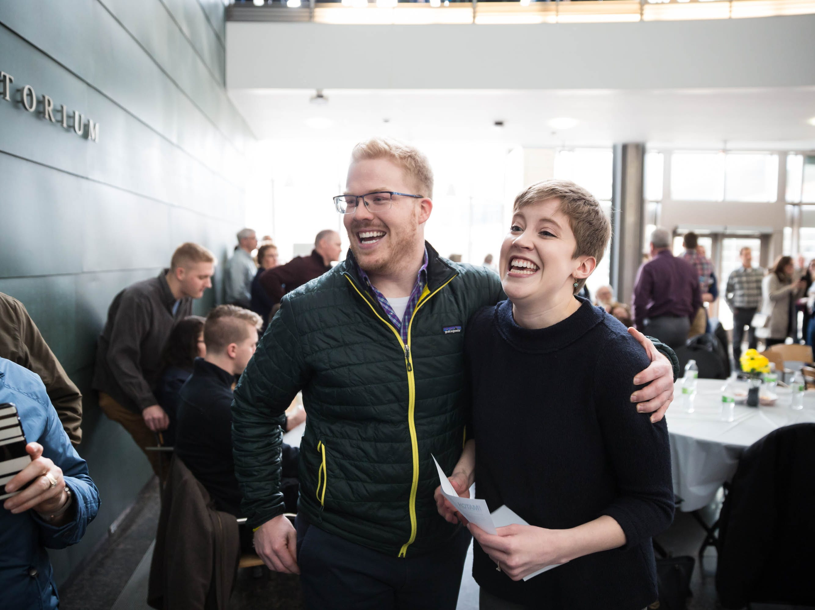Sarah Floden, right, celebrates getting matched with the University of Wisconsin with her fiancée Patrick Kolker during Match Day at UIHC in Iowa City on Friday, March 15, 2019.