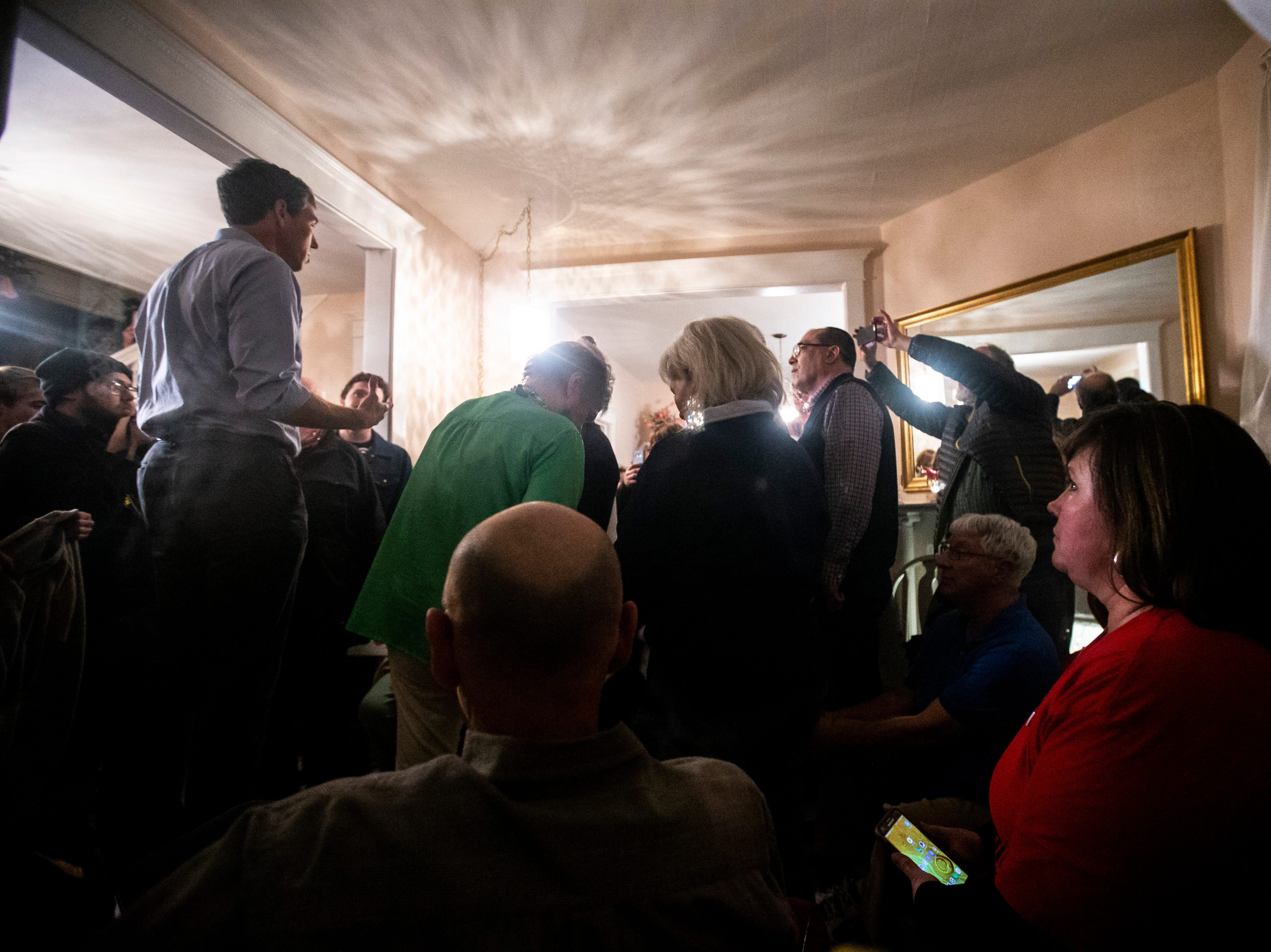 Democratic presidential candidate Beto O'Rourke, of Texas, speaks to a crowd at the end of his first day in the state since announcing his run, Thursday, March 14, 2019, at a home in Muscatine, Iowa.