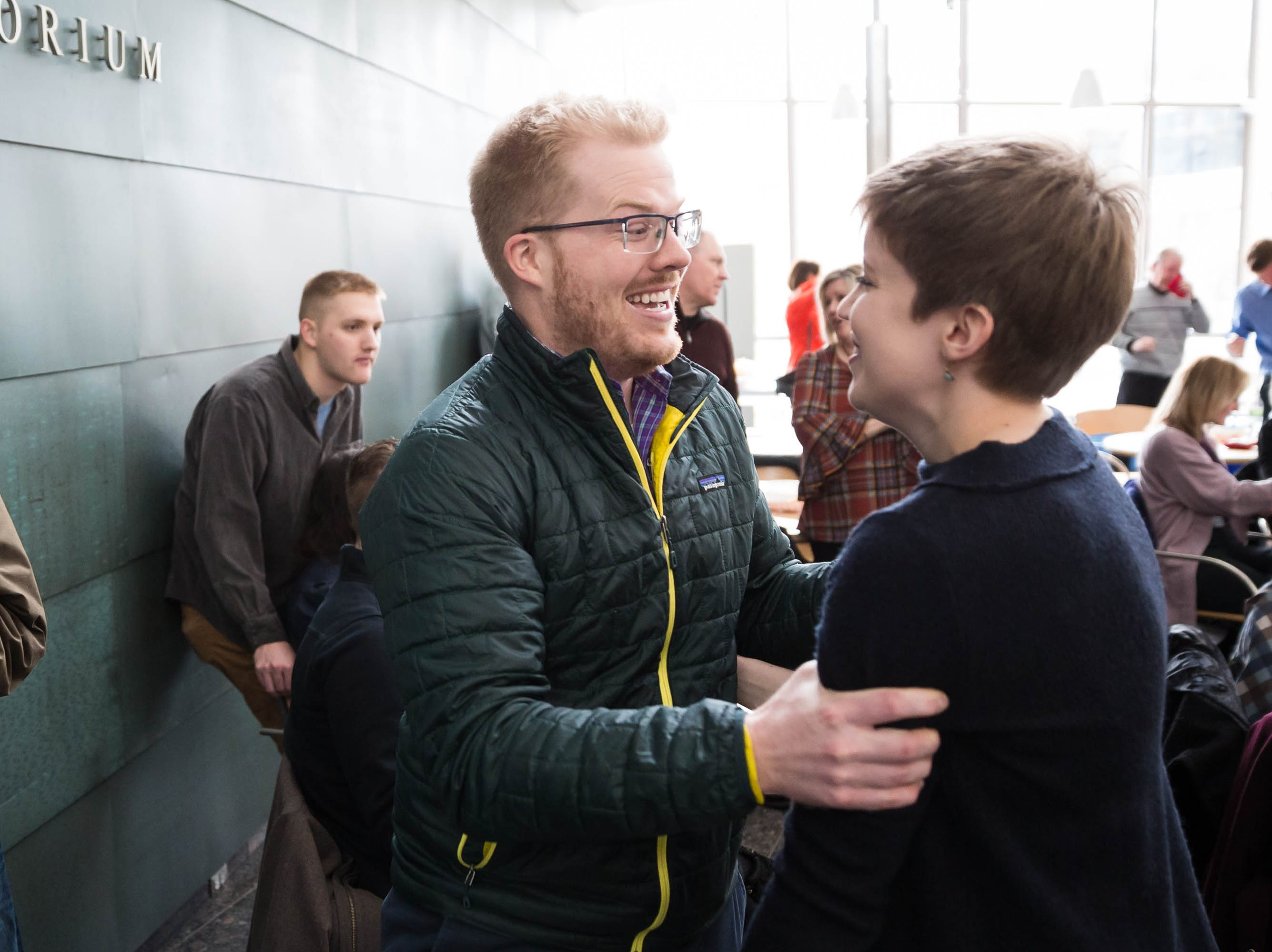 Sarah Floden, right celebrates getting matched with the University of Wisconsin with her fiancée Patrick Kolker during Match Day at UIHC in Iowa City on Friday, March 15, 2019.