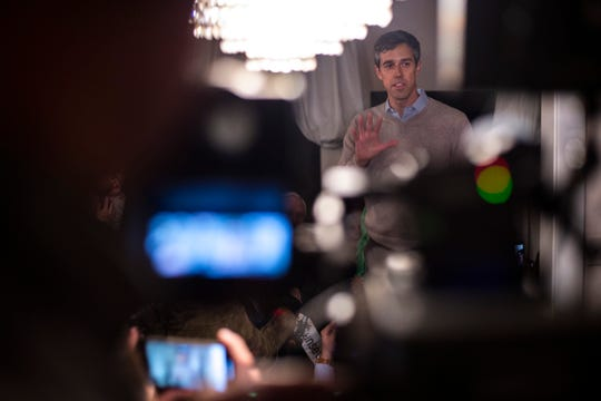 Democratic presidential candidate Beto O'Rourke speaks to a crowd at a home in Muscatine, Iowa, at the end of his first day in the state since announcing his run.