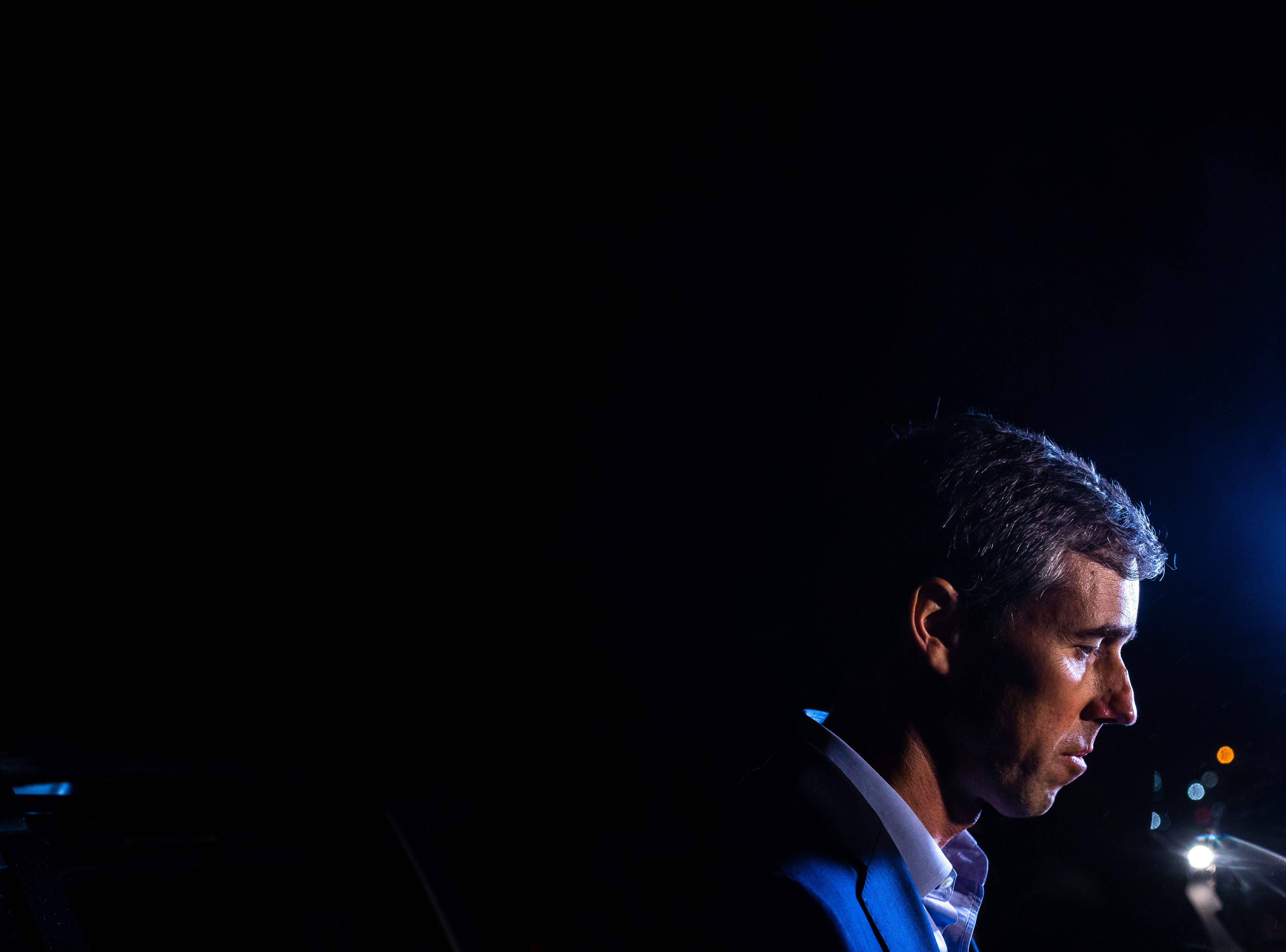 Democratic presidential candidate Beto O'Rourke, of Texas, speaks to reporters at the end of his first day in the state since announcing his run, Thursday, March 14, 2019, outside a home in Muscatine, Iowa.