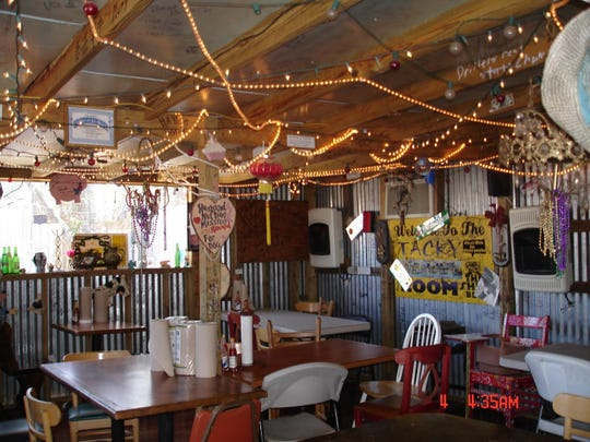 The Shed's decor is an eclectic mix of antiques, salvaged junk and rope lights.