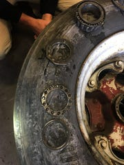 This Mississippi Department of Transportation photo shows parts after the wheel assembly was unpacked. A locking ring was missing.