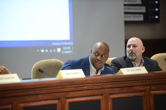JMCSS Superintendent Eric Jones and Chairman Kevin Alexander react to discussion about land options during the JMCSS board meeting at Jackson City Hall on Thursday night.