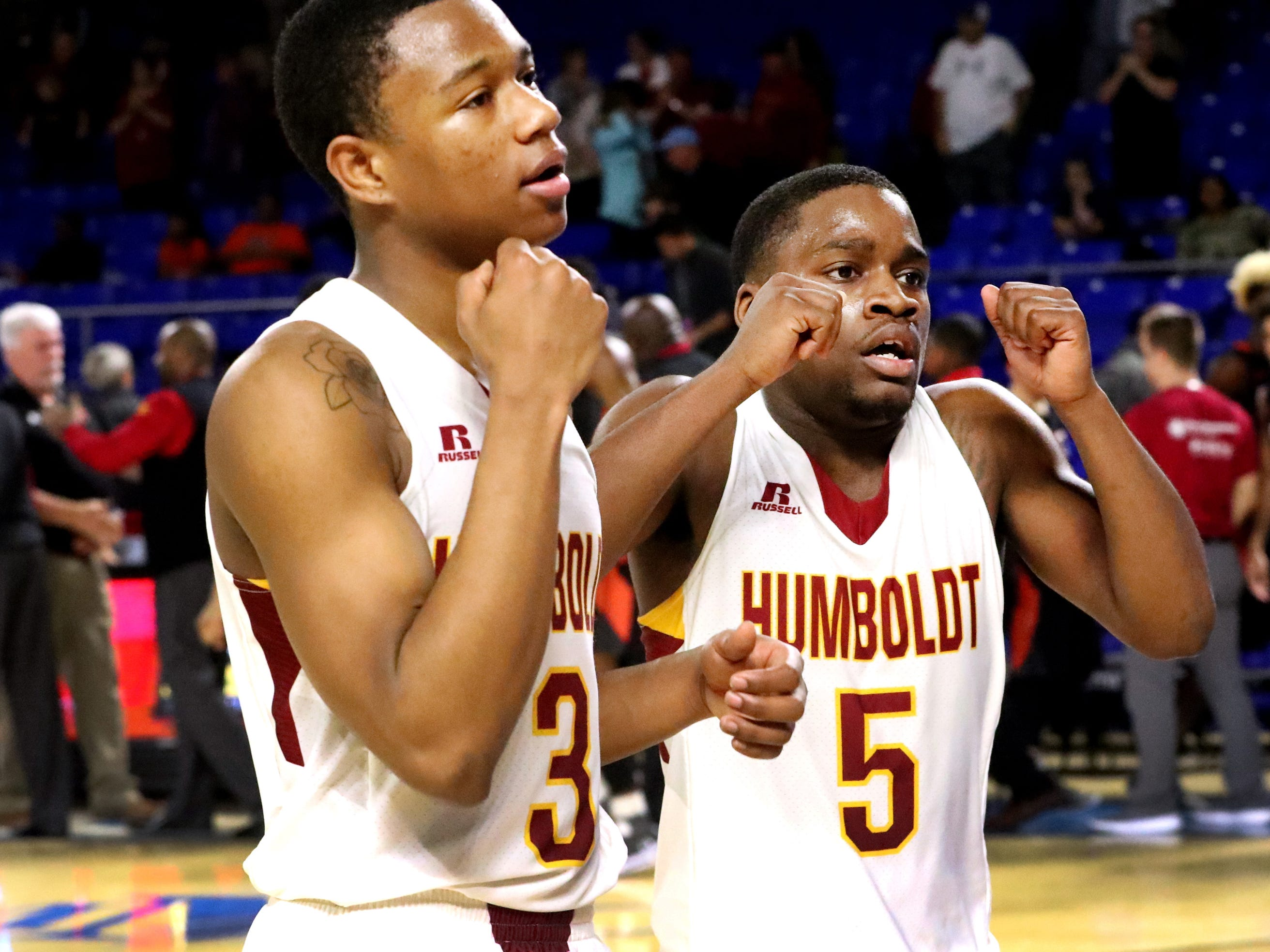 Humboldt's Trent Green (3) and Humboldt's Montrez Ward (5) celebrate beating Fayetteville 65-53 during the quarterfinal round of the TSSAA Class A Boys State Tournament, on Thursday, March 14, 2019, at Murphy Center in Murfreesboro, Tenn.