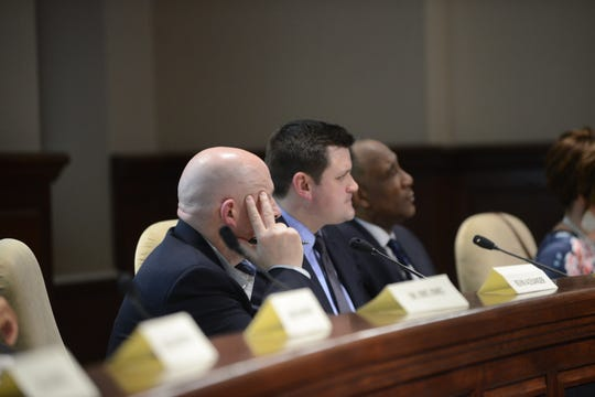 Chairman Kevin Alexander and board members AJ Massey and Morris Merriweather listen to public comments at the JMCSS board meeting at Jackson City Hall on Thursday night.