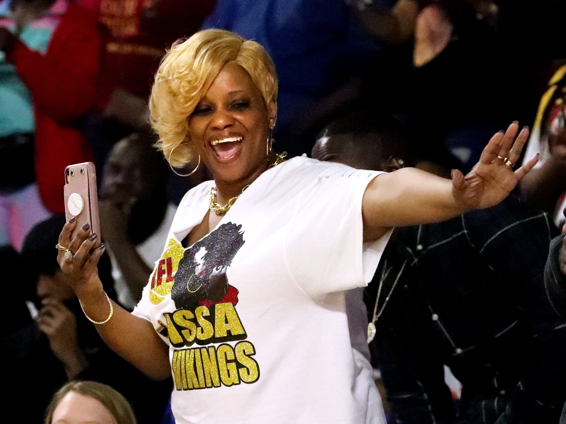 Humboldt fan Tracy Glenn celebrates in the crowd as Humboldt leads Fayetteville in the fourth quarter of the quarterfinal round of the TSSAA Class A Boys State Tournament, on Thursday, March 14, 2019, at Murphy Center in Murfreesboro, Tenn.
