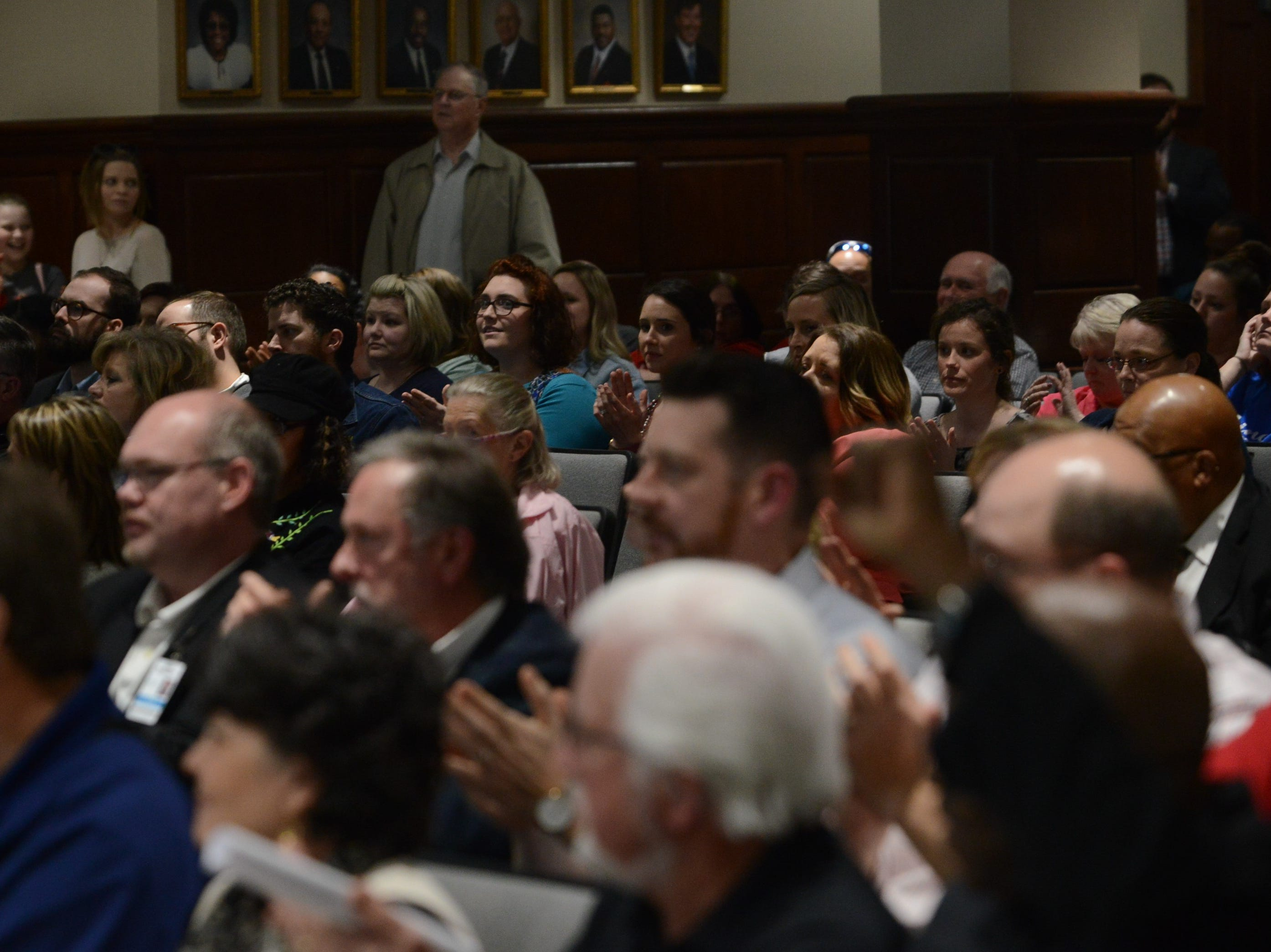 The crowd claps after as a speaker voices their public comment at the JMC school board meeting at Jackson City Hall on Thursday night.