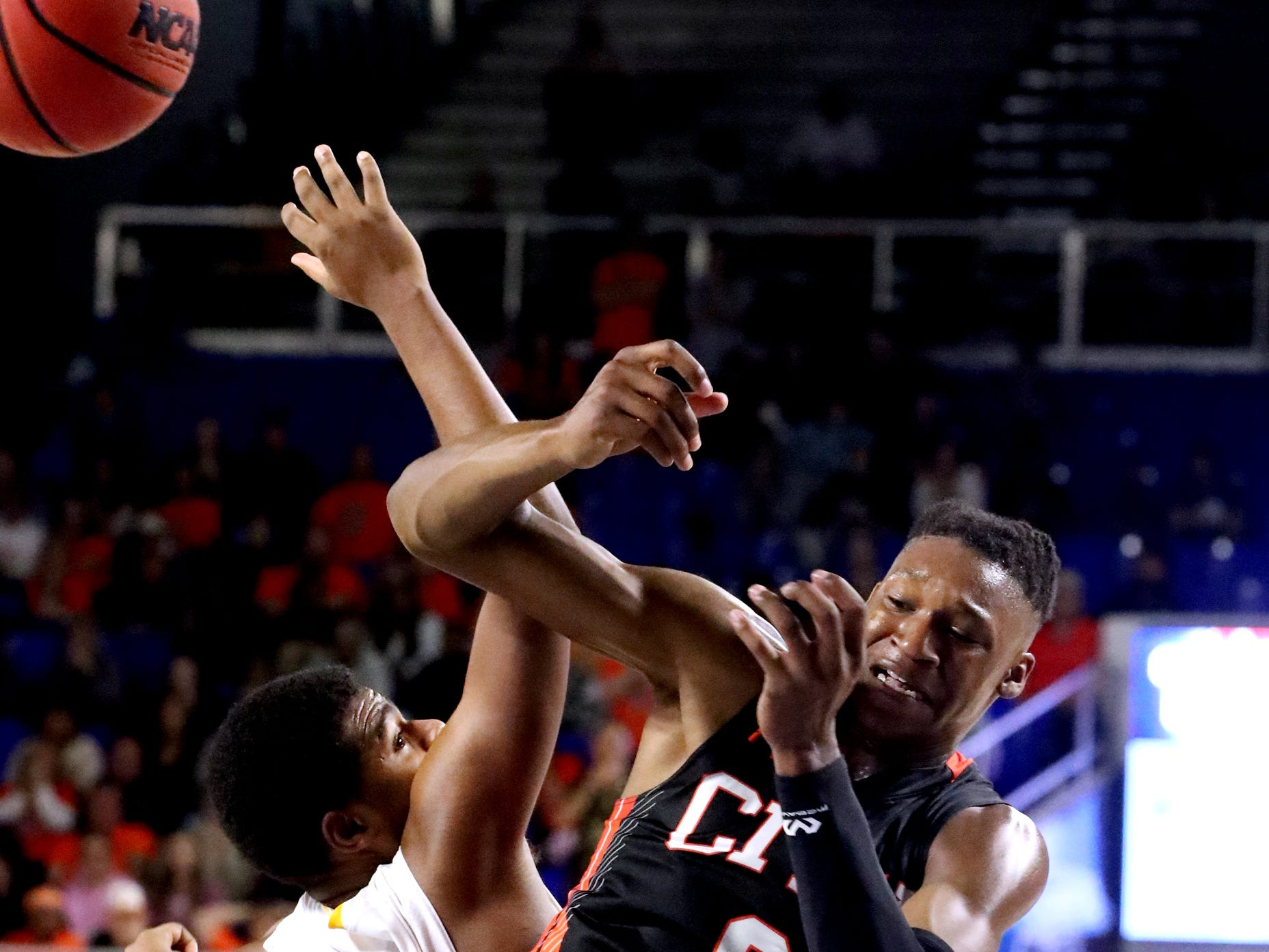 Humboldt's Reginald Manley (52) and Fayetteville's Julius Dixon (0) both go for a rebound during the quarterfinal round of the TSSAA Class A Boys State Tournament, on Thursday, March 14, 2019, at Murphy Center in Murfreesboro, Tenn.
