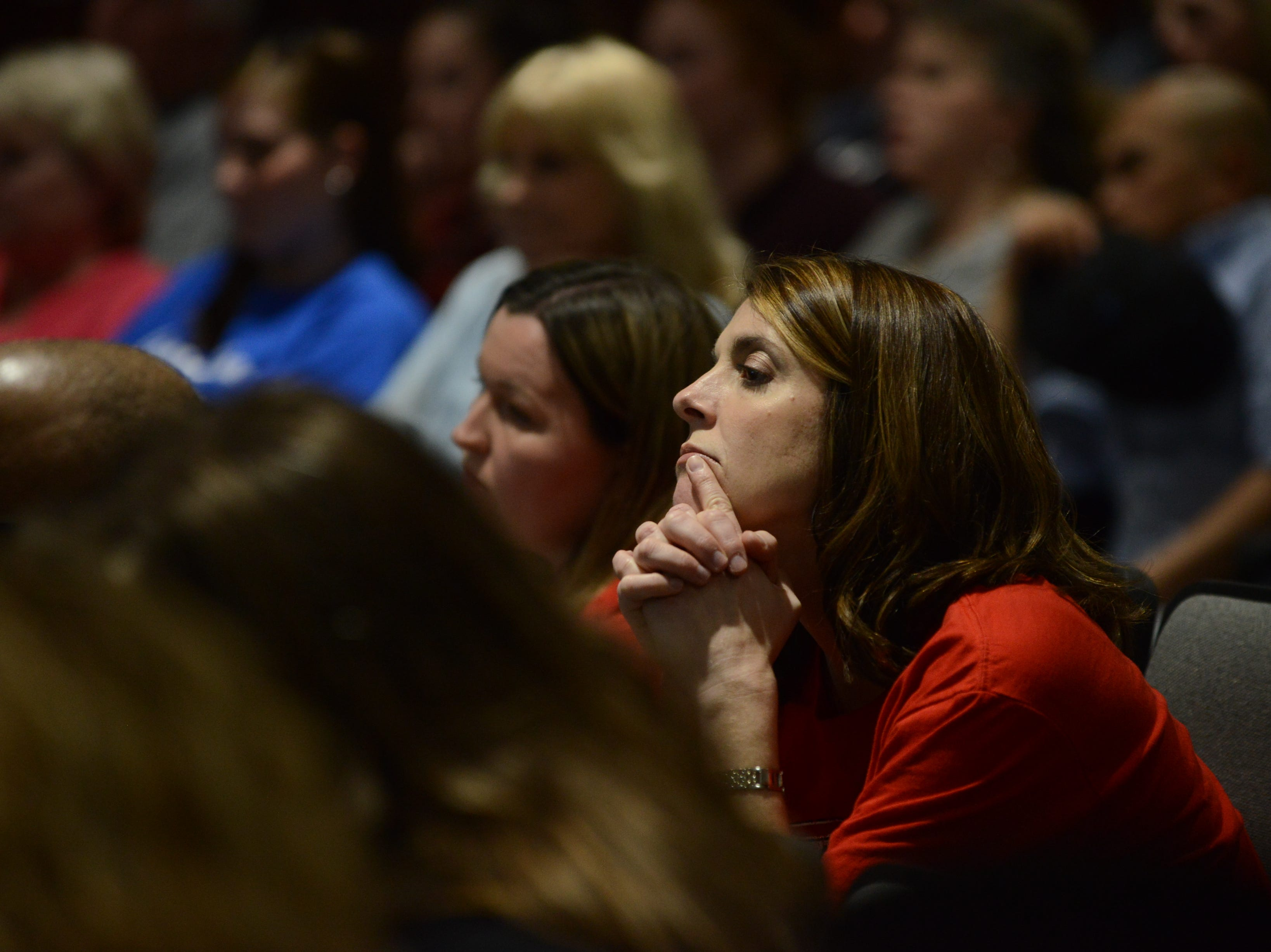 Pope Elementary School parent Ellen Neely listens intently as the school board discusses the Ashport Road land option during the JMC school board meeting at Jackson City Hall on Thursday night.