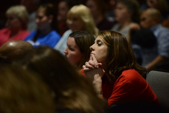 Pope Elementary School parent Ellen Neely listens intently as the school board discusses the Ashport Road land option during the JMC school board meeting at Jackson City Hall on Thursday, March 14.
