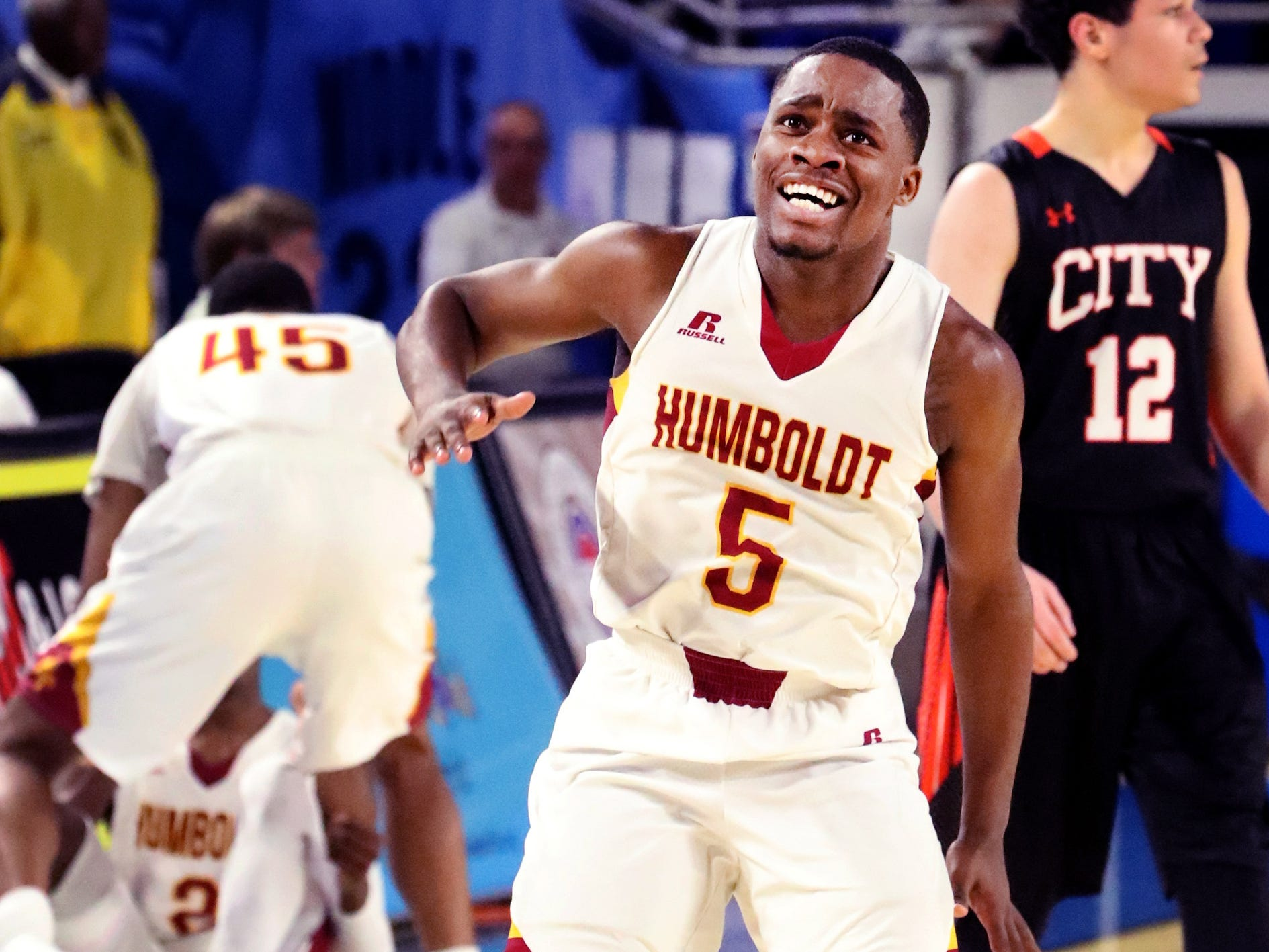 Humboldt's Montrez Ward (5) celebrates a call and Humboldt getting the ball back from Fayetteville during the quarterfinal round of the TSSAA Class A Boys State Tournament, on Thursday, March 14, 2019, at Murphy Center in Murfreesboro, Tenn.