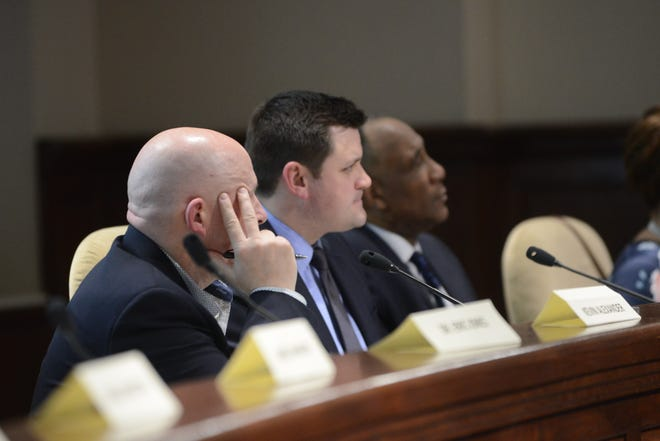 Chairman Kevin Alexander and board members AJ Massey and Morris Merriweather listen to public comments during the JMC school board meeting at Jackson City Hall on Thursday night.