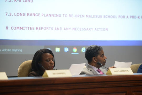 JMCSS board members Janice Hampton and James Johnson review information related to land options at the JMCSS board meeting at Jackson City Hall on Thursday night.
