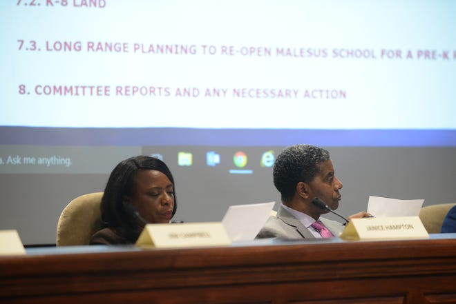 JMCSS board members Janice Hampton and James Johnson review information related to land options at the JMCSS board meeting at Jackson City Hall in March.