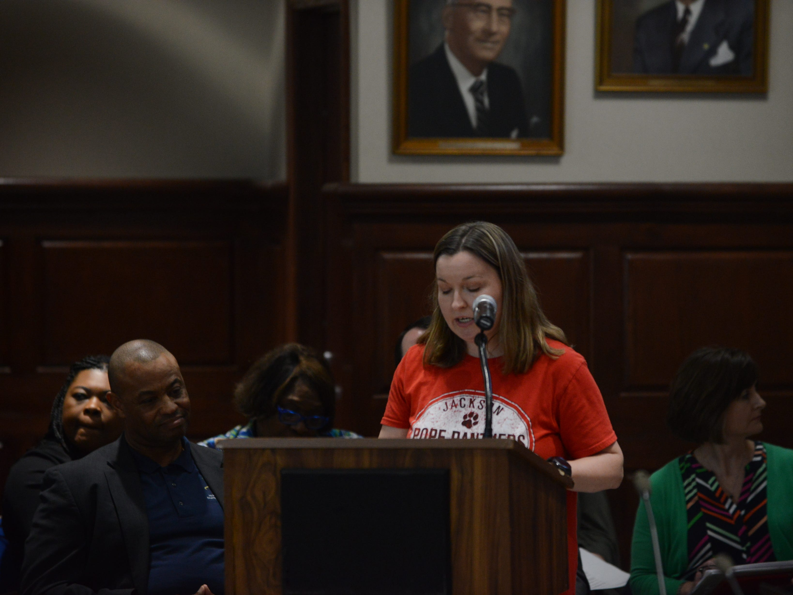 Lizzy Belew, the president of the Pope Elementary School PTO, speaks about safety and lack of space during public comment at the JMC school board meeting at Jackson City Hall on Thursday night.