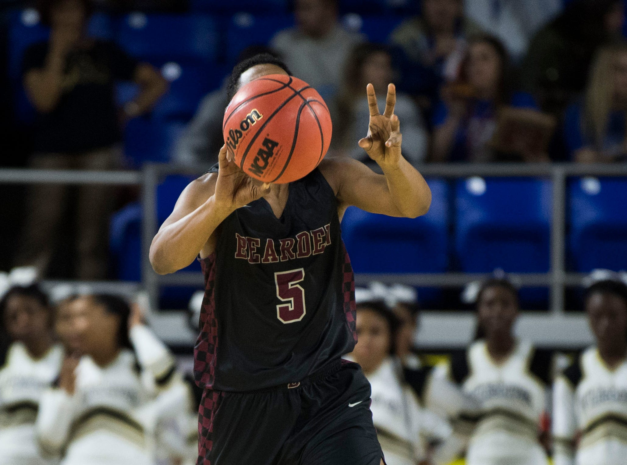 Bearden's Austin Pruitt (5) looks to passduring a TSSAA AAA state semifinal game between Whitehaven and Bearden at the Murphy Center in Murfreesboro, Friday, March 15, 2019. Bearden defeated Whitehaven 76-60.