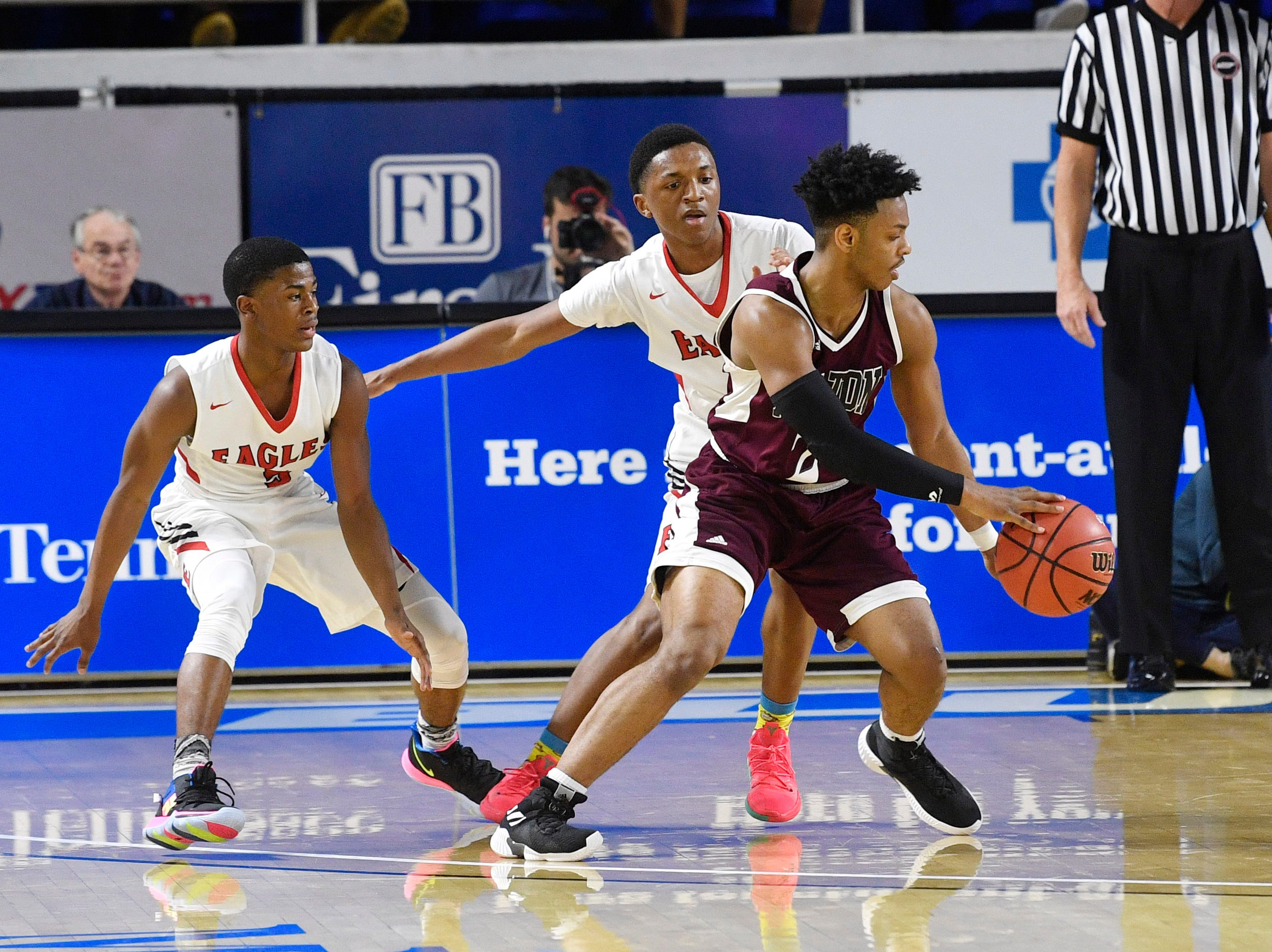 Fulton Ron Davis III (2) is surrounded by defenders as East Nashville plays Fulton in the TSSAA Class AA semifinal  Friday, March 15, 2019, in Murfreesboro, Tenn.