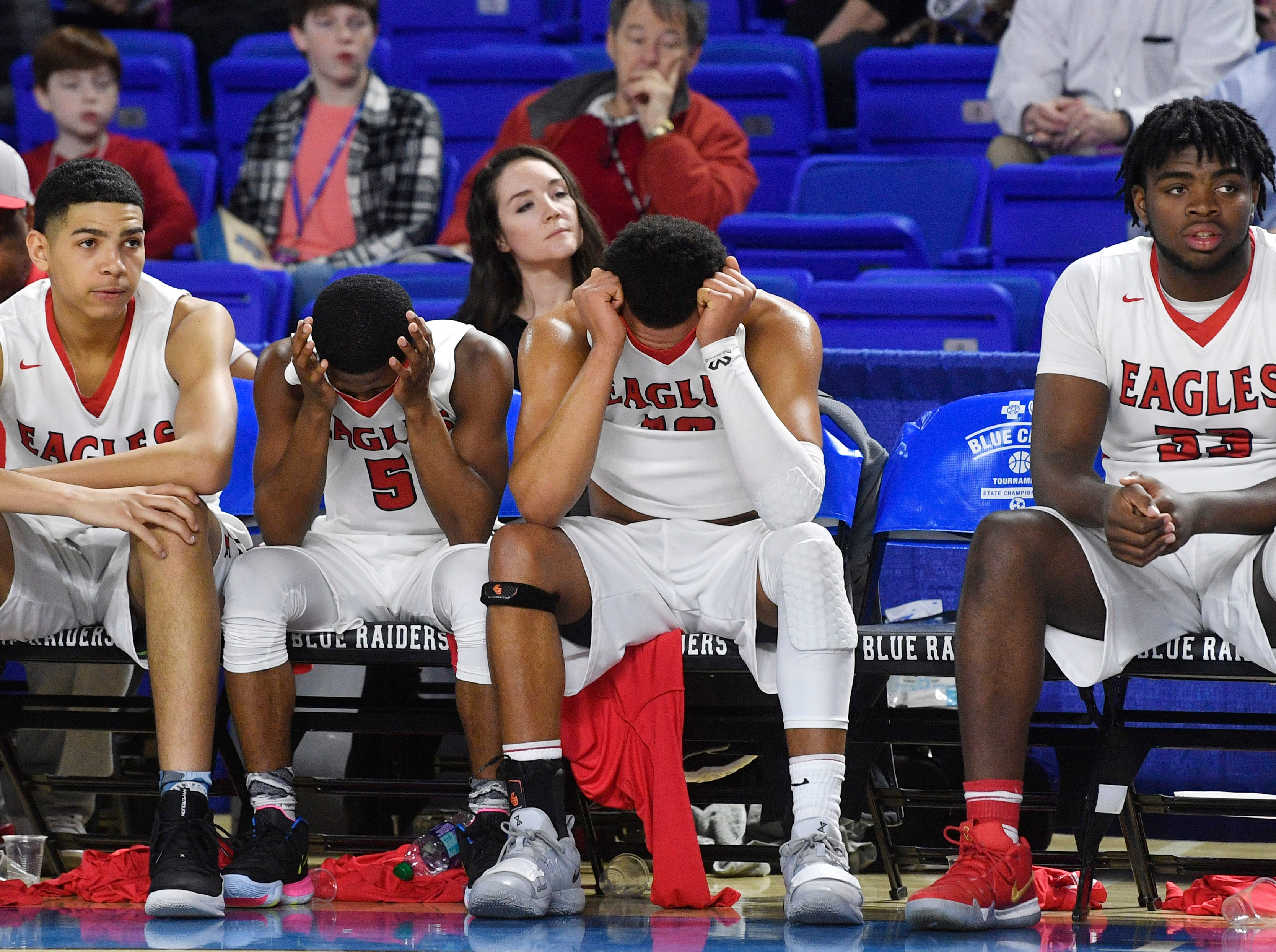 The East Nashville bench at the end of the game reflected the score as they were defeated 66-55 by Fulton in the TSSAA Class AA semifinal  Friday, March 15, 2019, in Murfreesboro, Tenn.