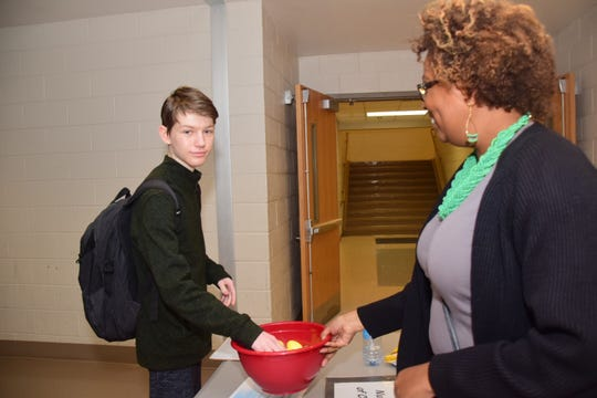 """Junior Mark Llshuvski chooses an egg from PTSA president Sheryl Ely telling him he has three children to pay for during """"My Amazing Life"""" held at Hardin Valley Academy Thursday, March 14."""