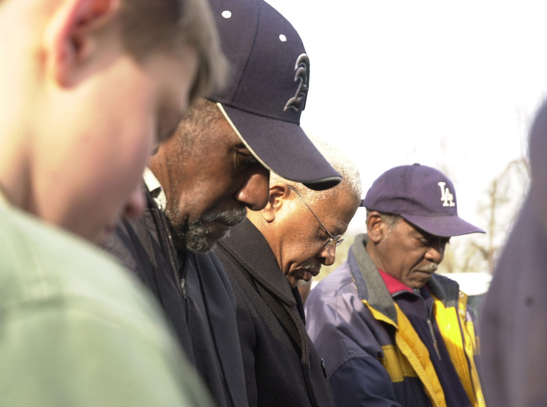 "Anderson County Learning Center student Jason Foster, foreground, joins three of the original ""Clinton 12"", the first black students to integrate a formerly all-white southern public school, in prayer Friday before they re-enacted the historic walk down Clinton's Broad Street. From left: Alfred Williams, Bobby Cain and Maurice Soles.  Feb. 10, 2006"
