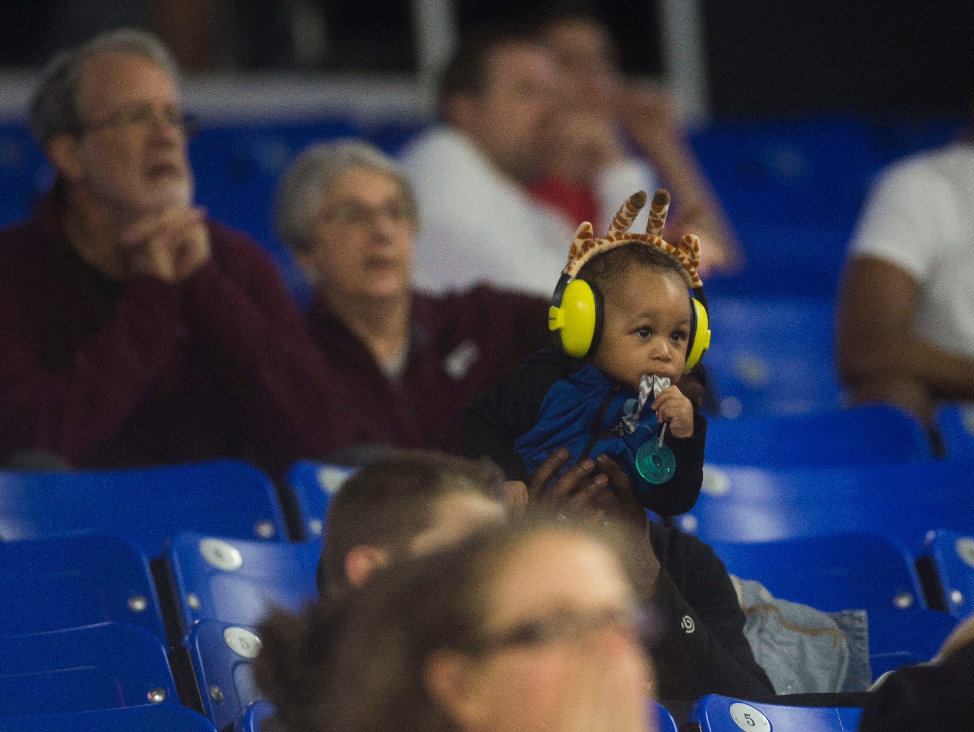 A young Fulton fan watches on during a TSSAA AA state semifinal game between East Nashville and Fulton at the Murphy Center in Murfreesboro, Friday, March 15, 2019. Fulton defeated East Nashville 66-55.