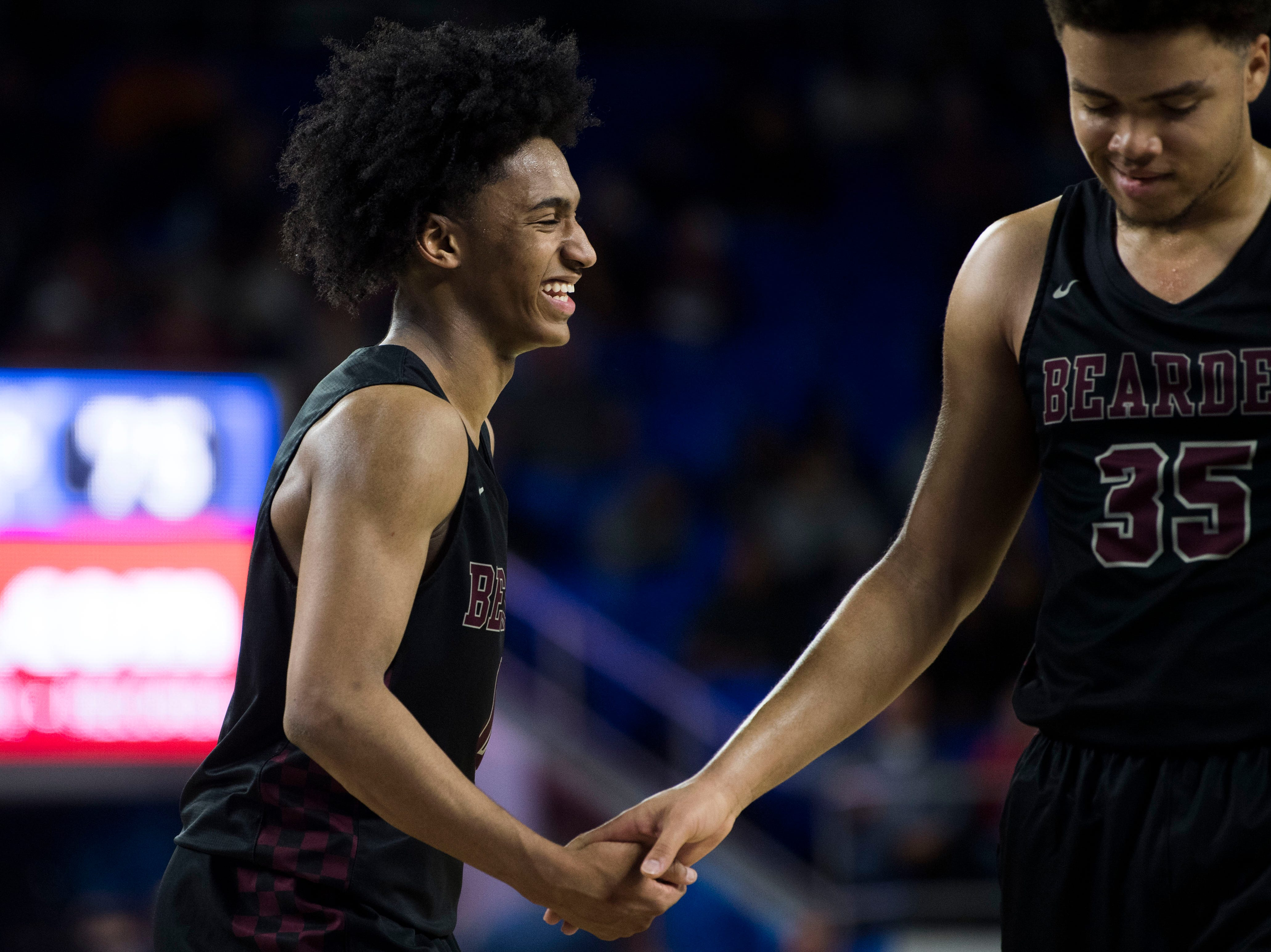 Bearden's Ques Glover (0) celebrates with Bearden's Shamarcus Brown (35) during a TSSAA AAA state semifinal game between Whitehaven and Bearden at the Murphy Center in Murfreesboro, Friday, March 15, 2019. Bearden defeated Whitehaven 76-60.