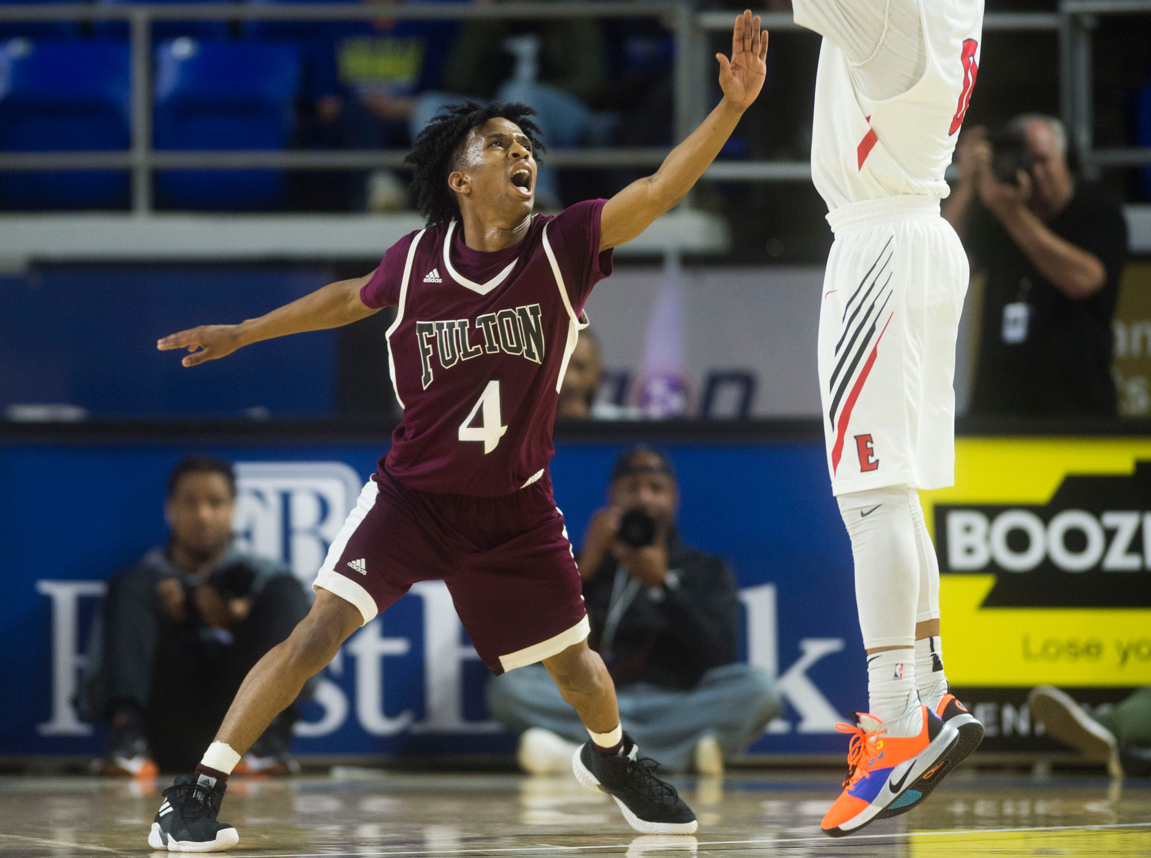 Fulton's Edward Lacy (4) defends East NashvilleÕs Taras Carter (0) during a TSSAA AA state semifinal game between East Nashville and Fulton at the Murphy Center in Murfreesboro, Friday, March 15, 2019. Fulton defeated East Nashville 66-55.
