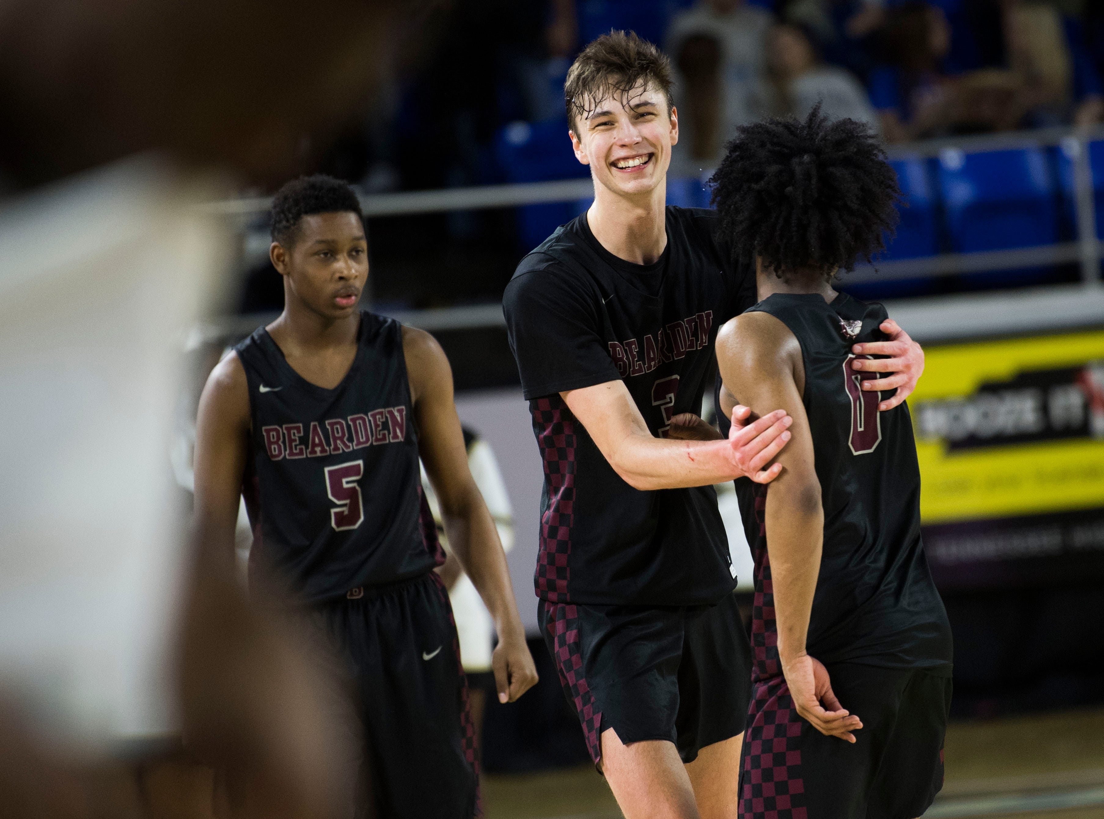 Bearden's Drew Pember (3) congratulates Bearden's Ques Glover (0) after a TSSAA AAA state semifinal game between Whitehaven and Bearden at the Murphy Center in Murfreesboro, Friday, March 15, 2019. Bearden defeated Whitehaven 76-60.