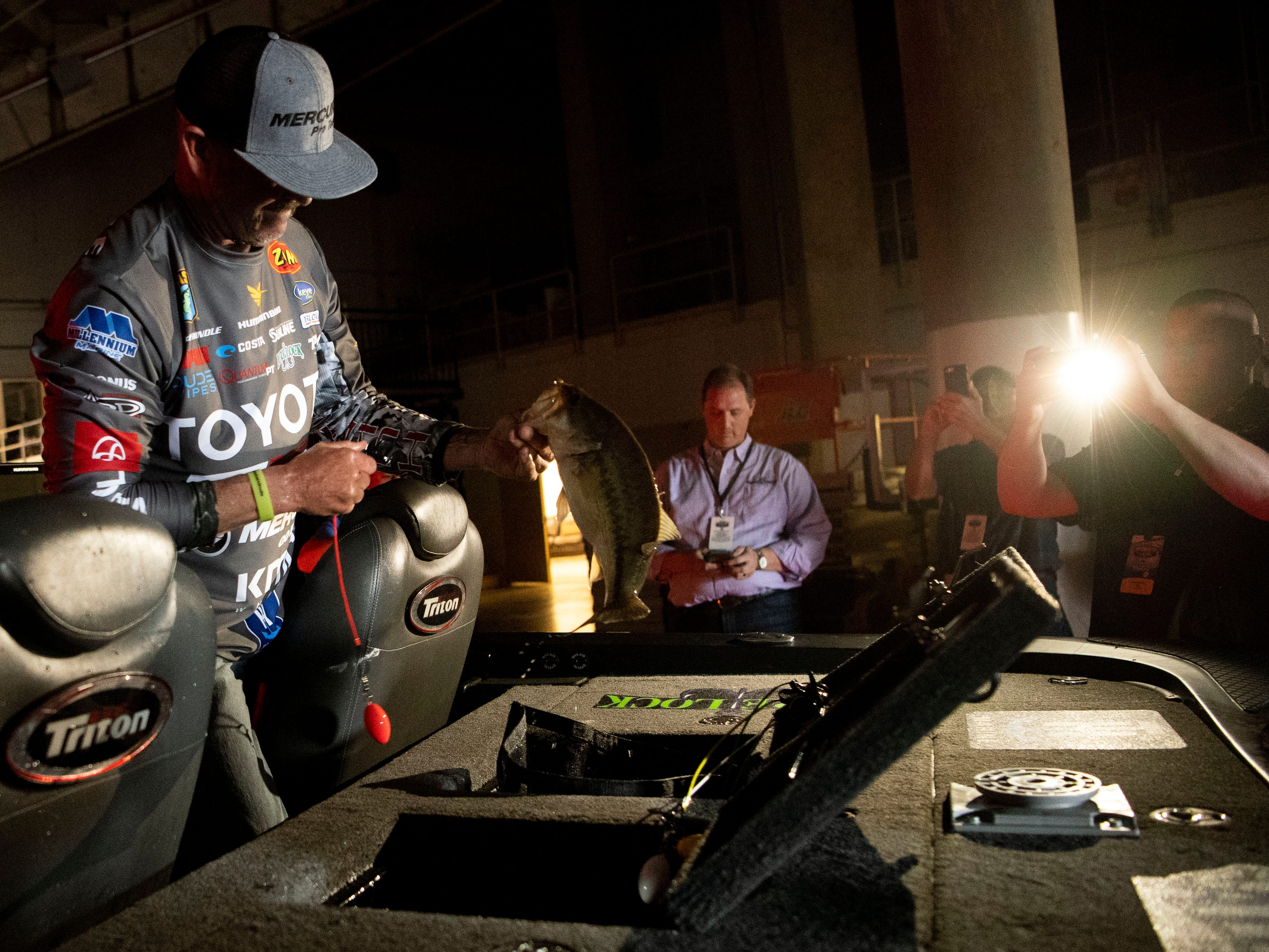 Professional bass fisherman Gerald Swindle prepares his day's catch for weigh-in during the GEICO Bassmaster Classic presented by DICK'S Sporting Goods at Thompson-Boling Arena on Friday, March 15, 2019.